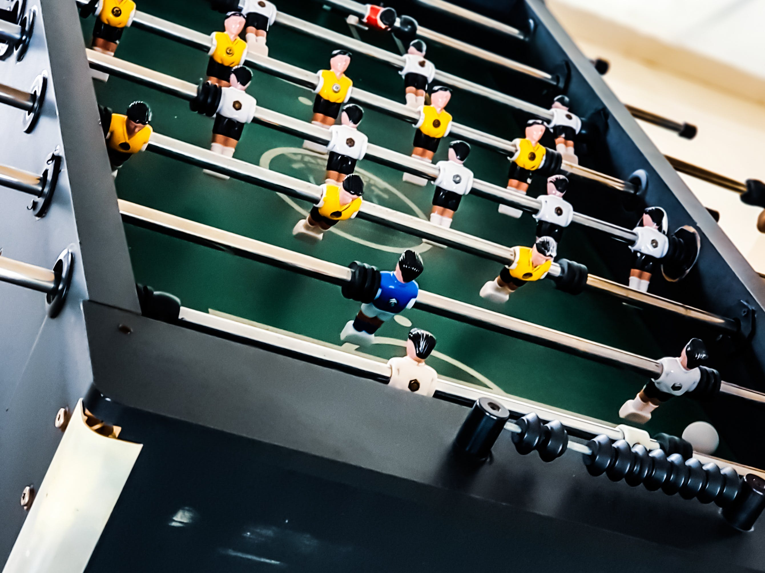 Closeup Photo of Black and Green Foosball Table
