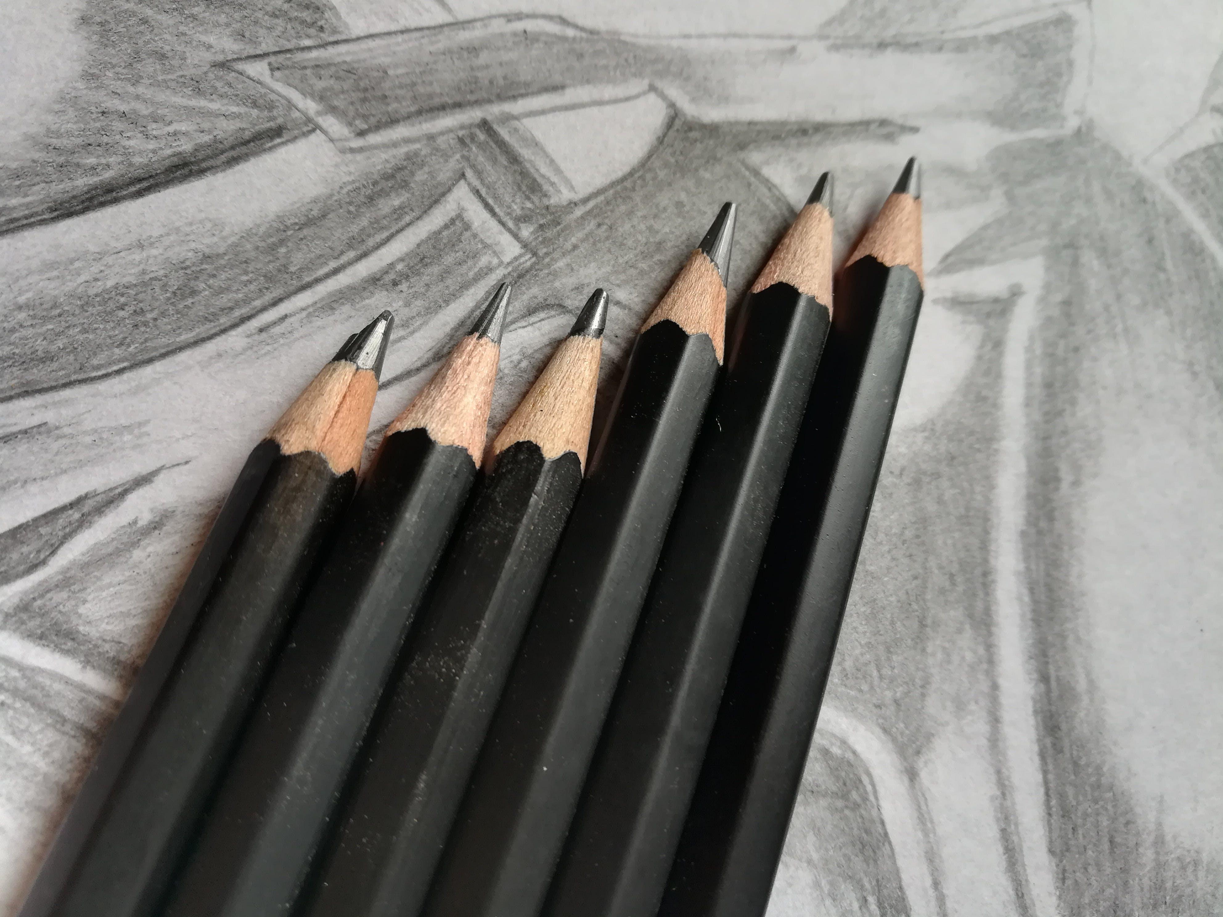 Free stock photo of artistic, Black matta, black pencils, book pages