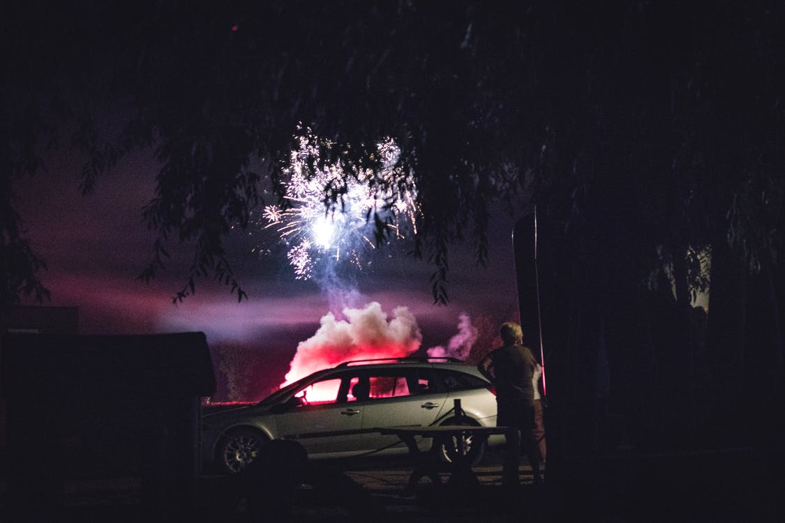 Gray Station Wagon Parked Beside the Tree during Nighttime