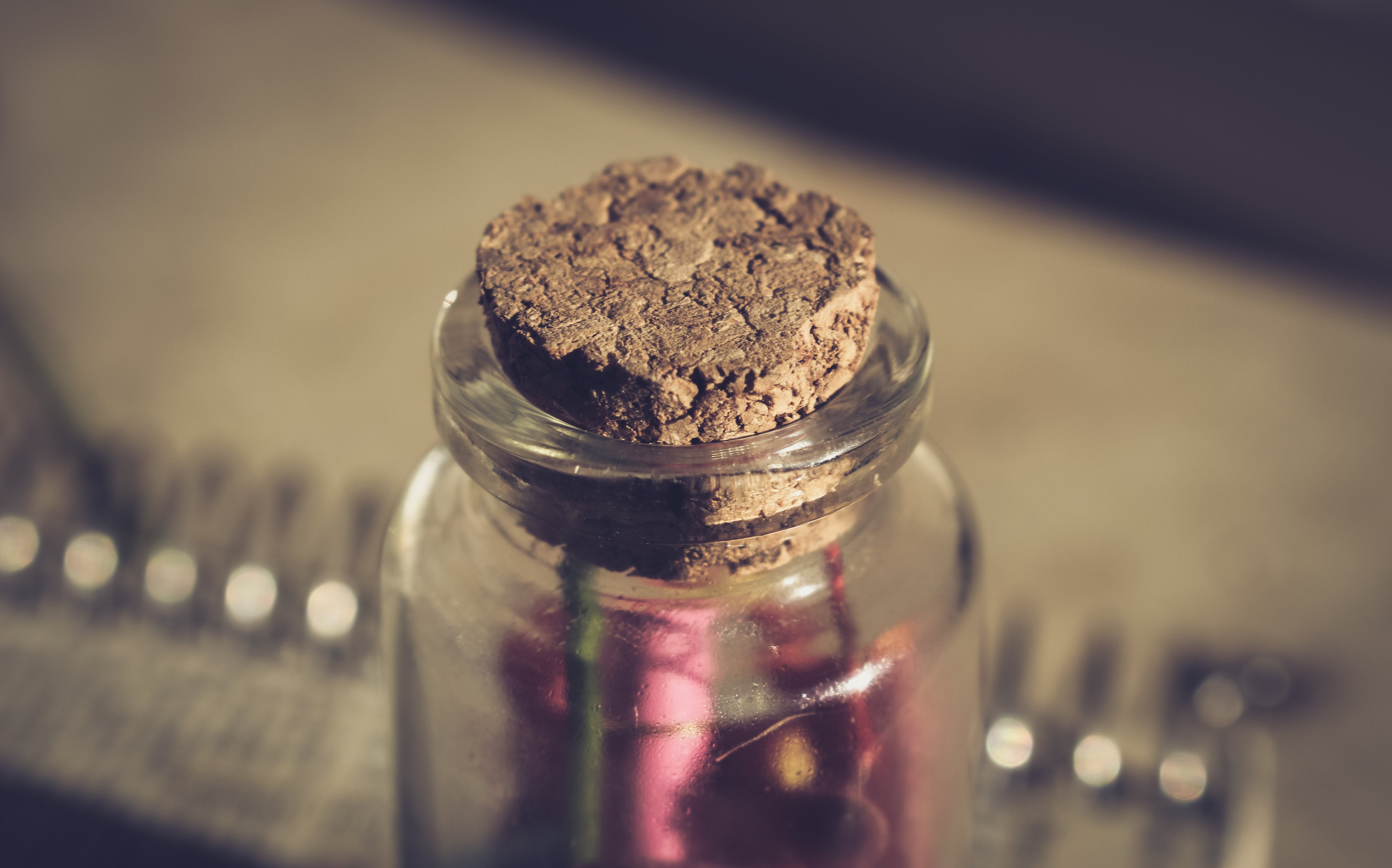 Selective Focus Photo of Bottle With Cork