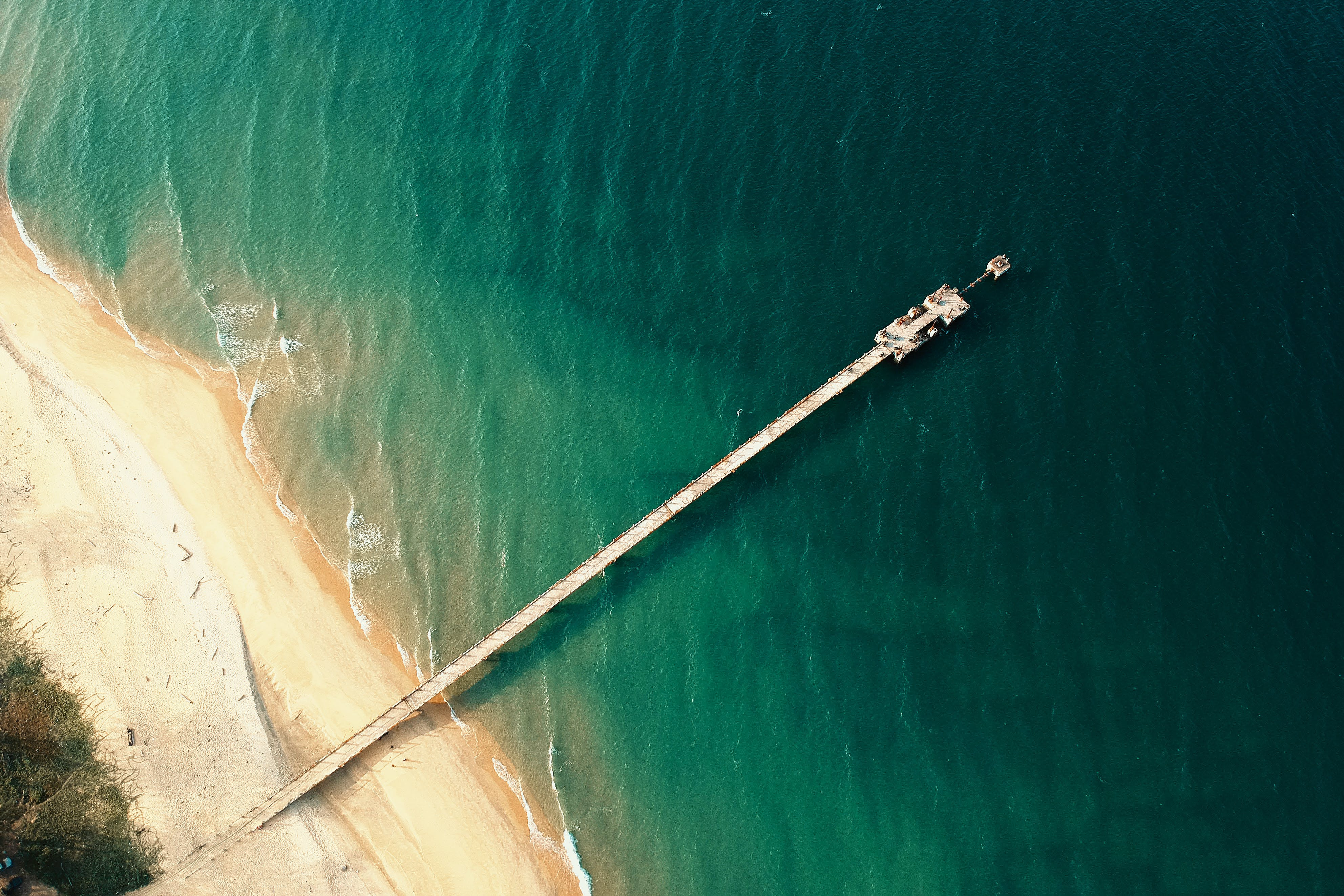 Aerial Photography of Wooden Dock Near Seashore
