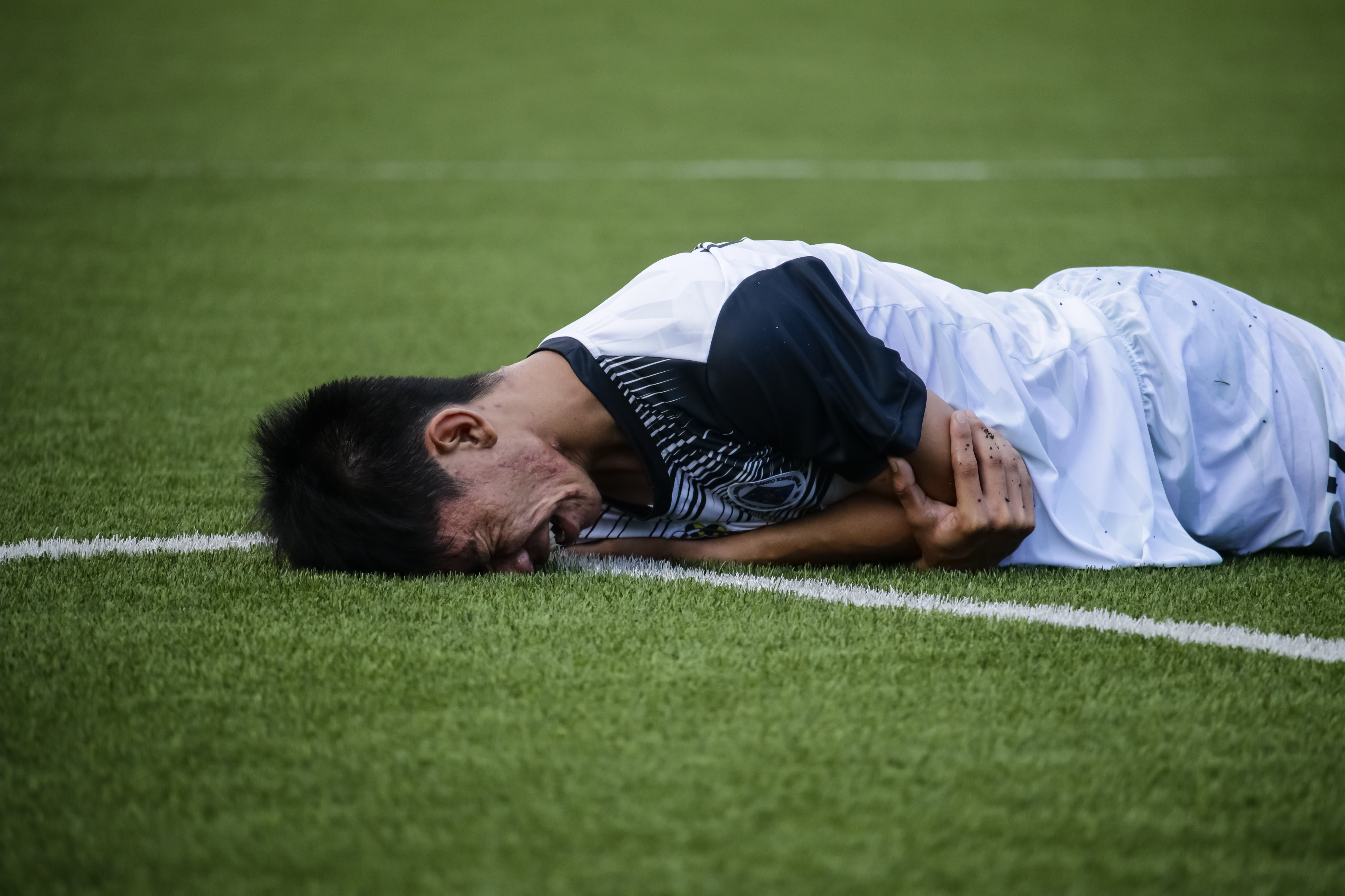 Man Crying on Field