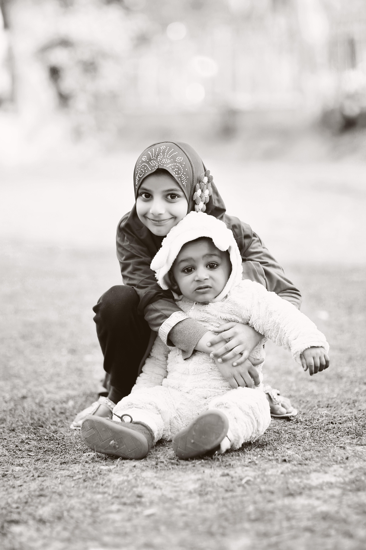 Grayscale Photography Of Girl Hugging Baby