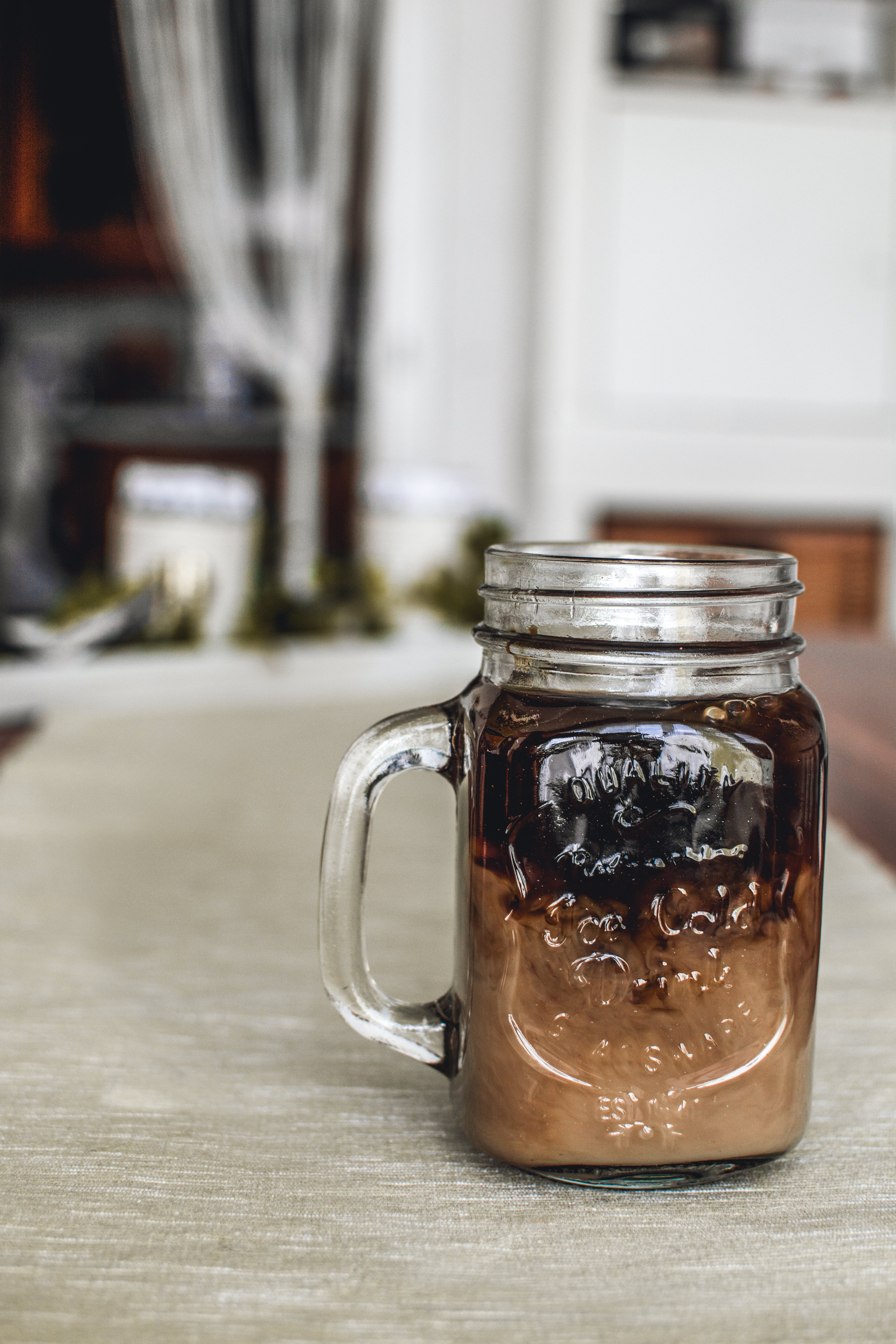 Mason Jar On Brown Surface