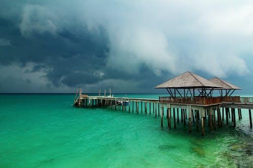 bulutlar, deniz, fırtına, iskele içeren Ücretsiz stok fotoğraf