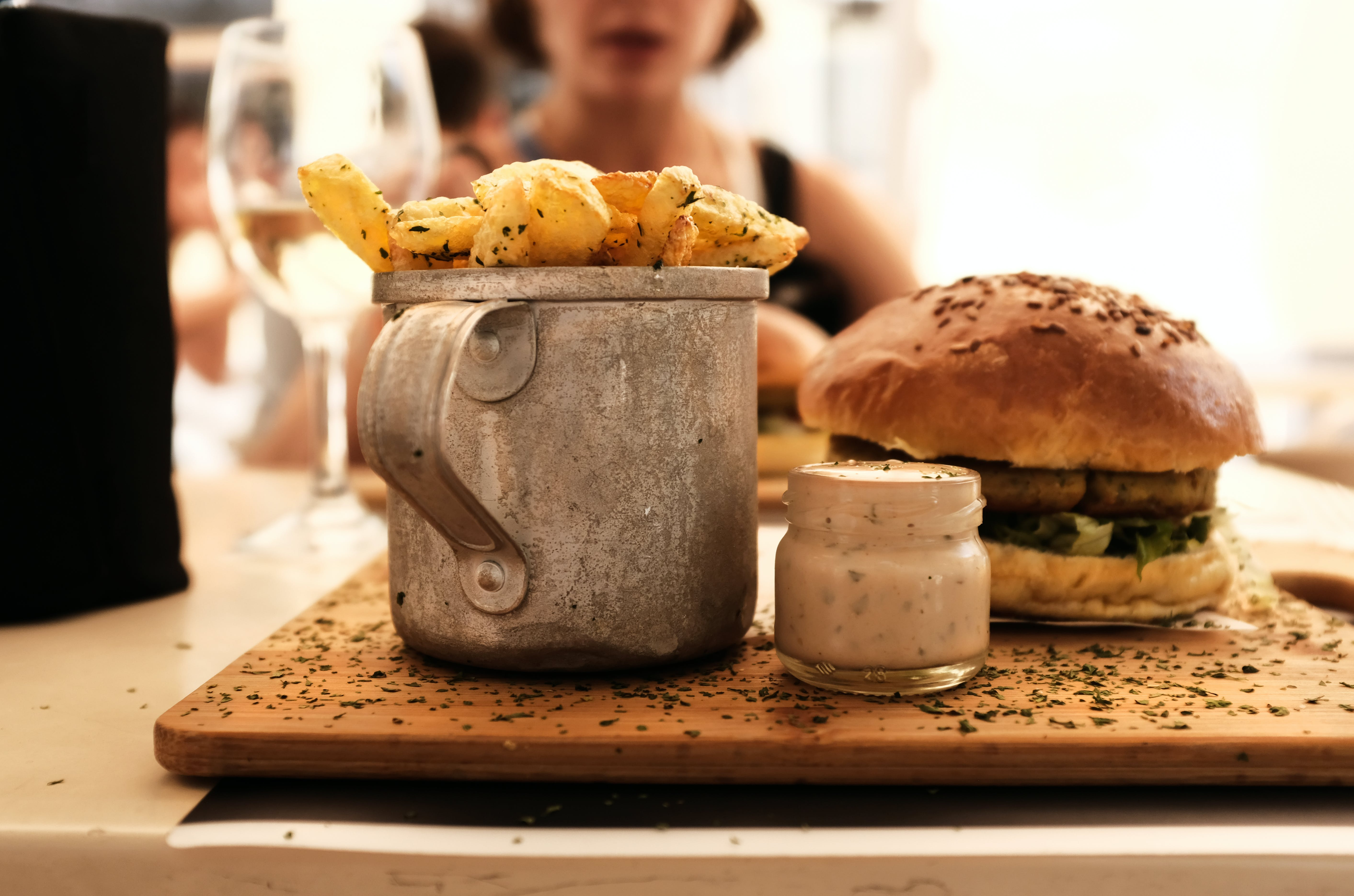 Shallow Focus Photography of Hamburger Beside Container