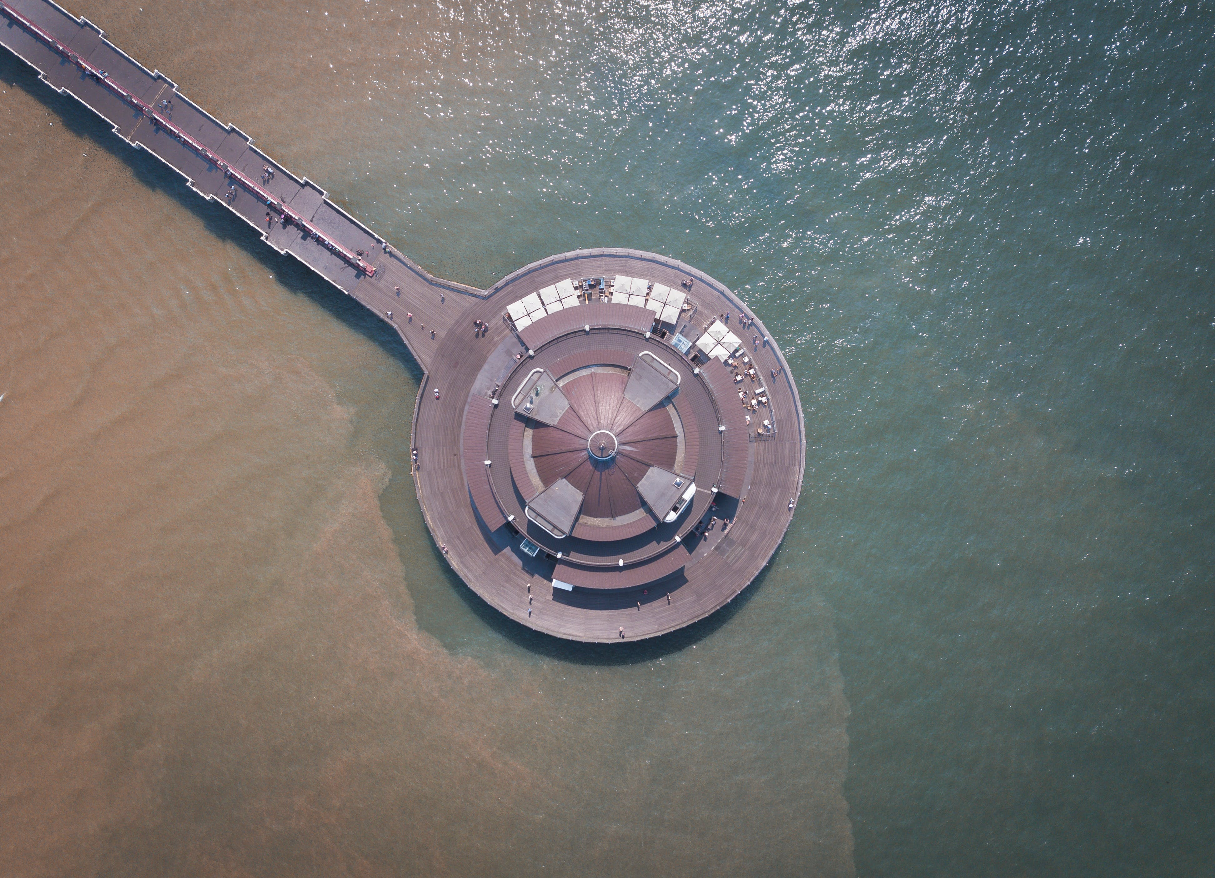 Aerial Photography of Round Brown Structure on Ocean