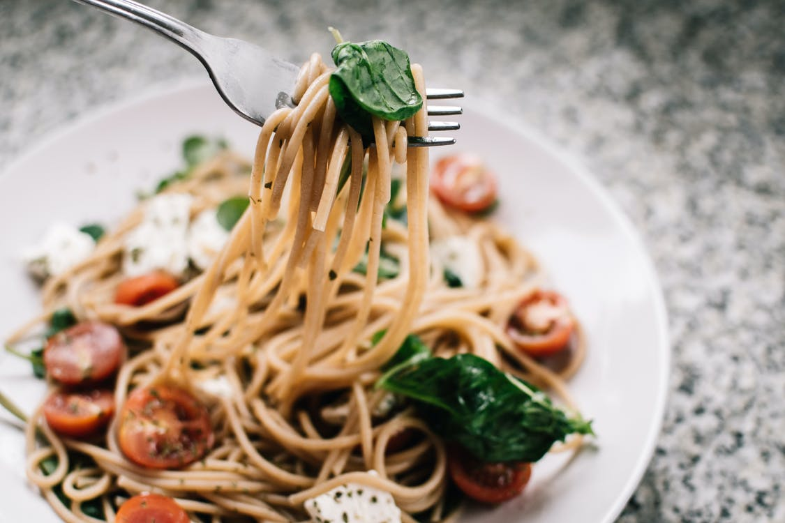 Selective Focus Photography of Pasta With Tomato and Basil