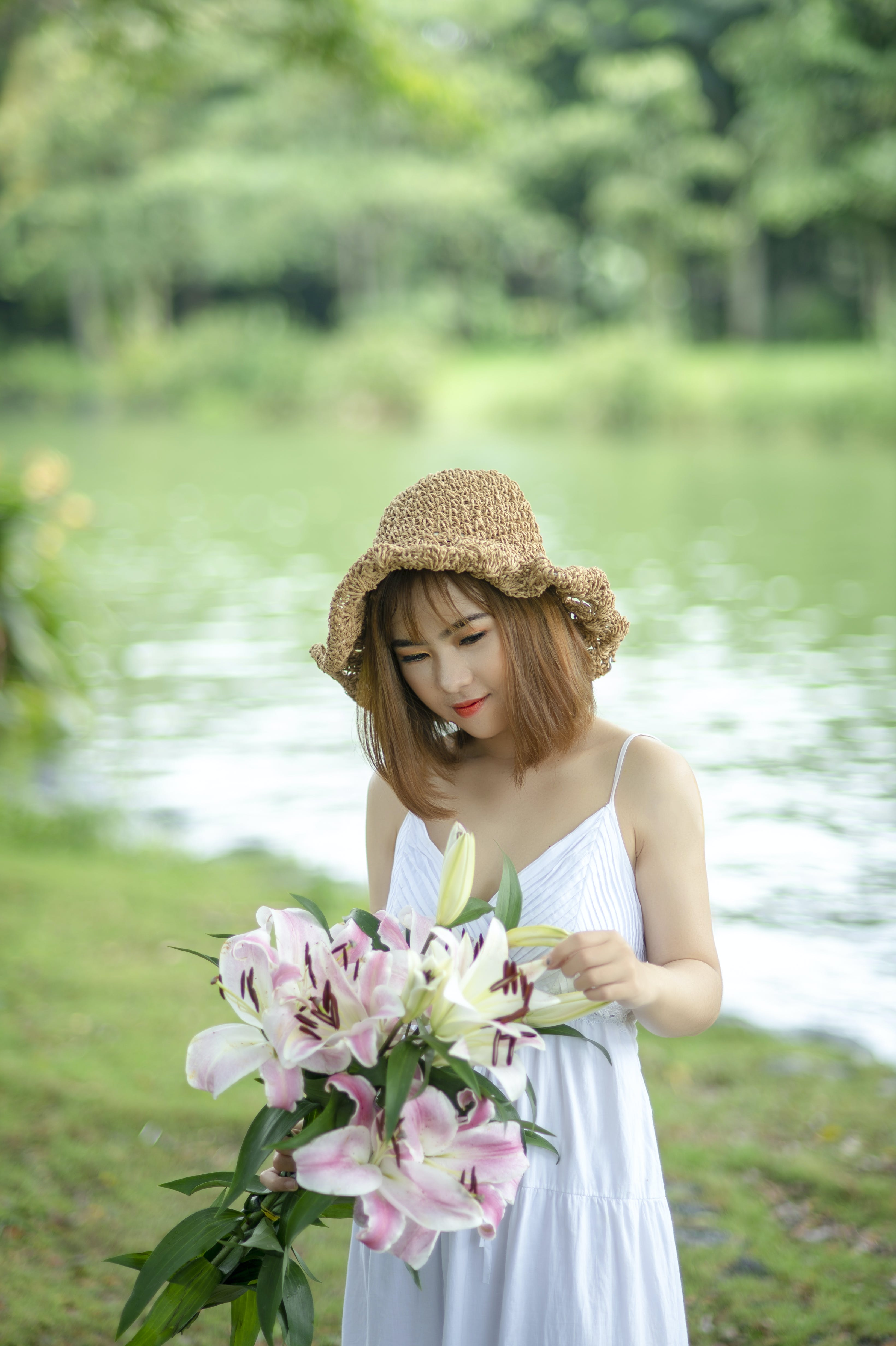 Photo of Woman Holding Bouquet of Flowers.