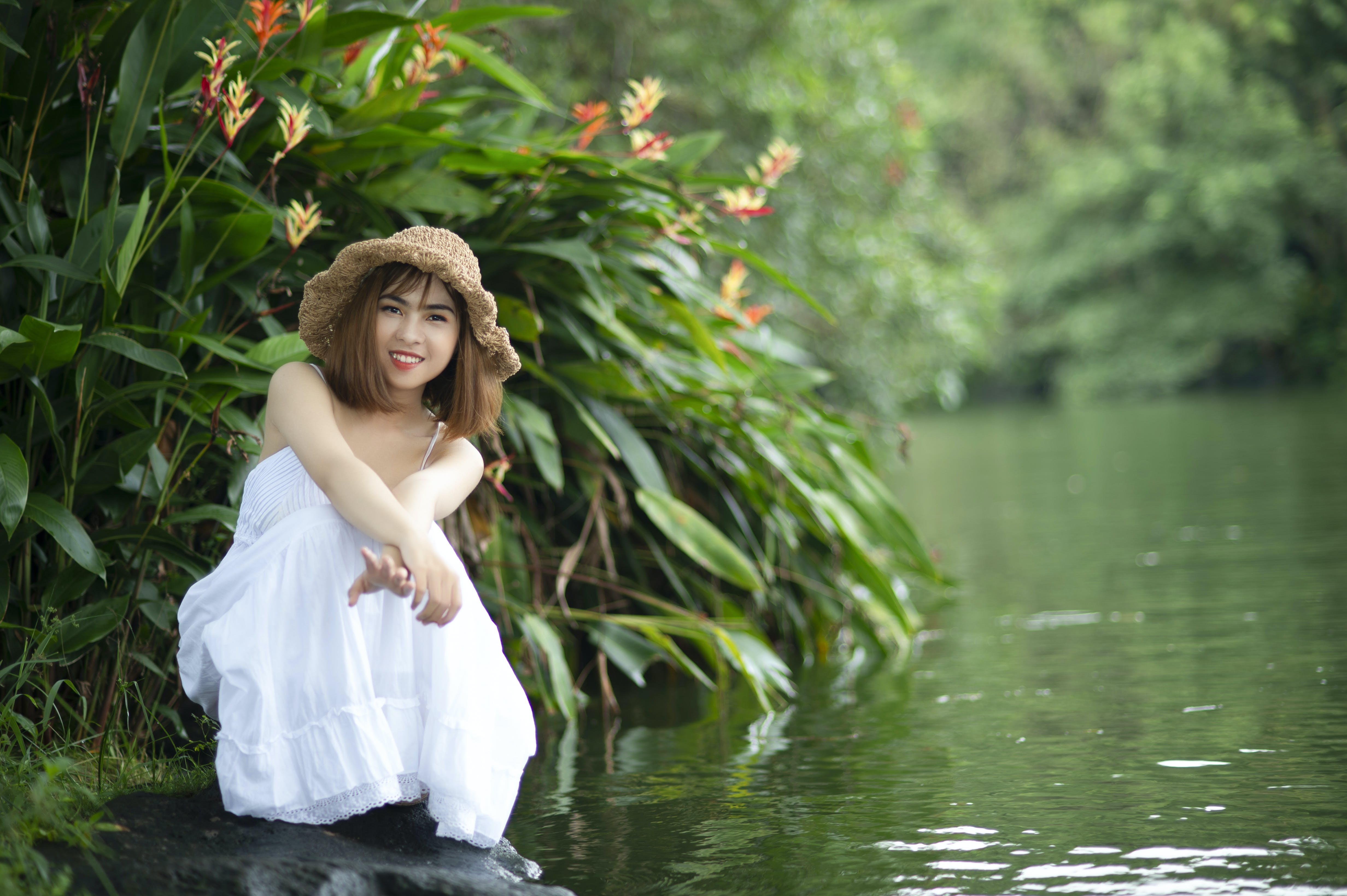 Woman Wearing White Dress Near Body of Water