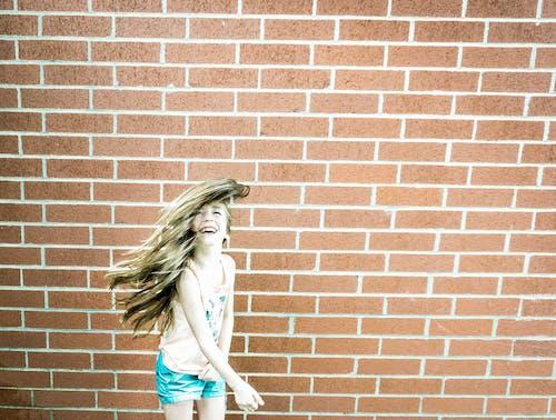 Free stock photo of cute girl, girl, hair flip, hair flying