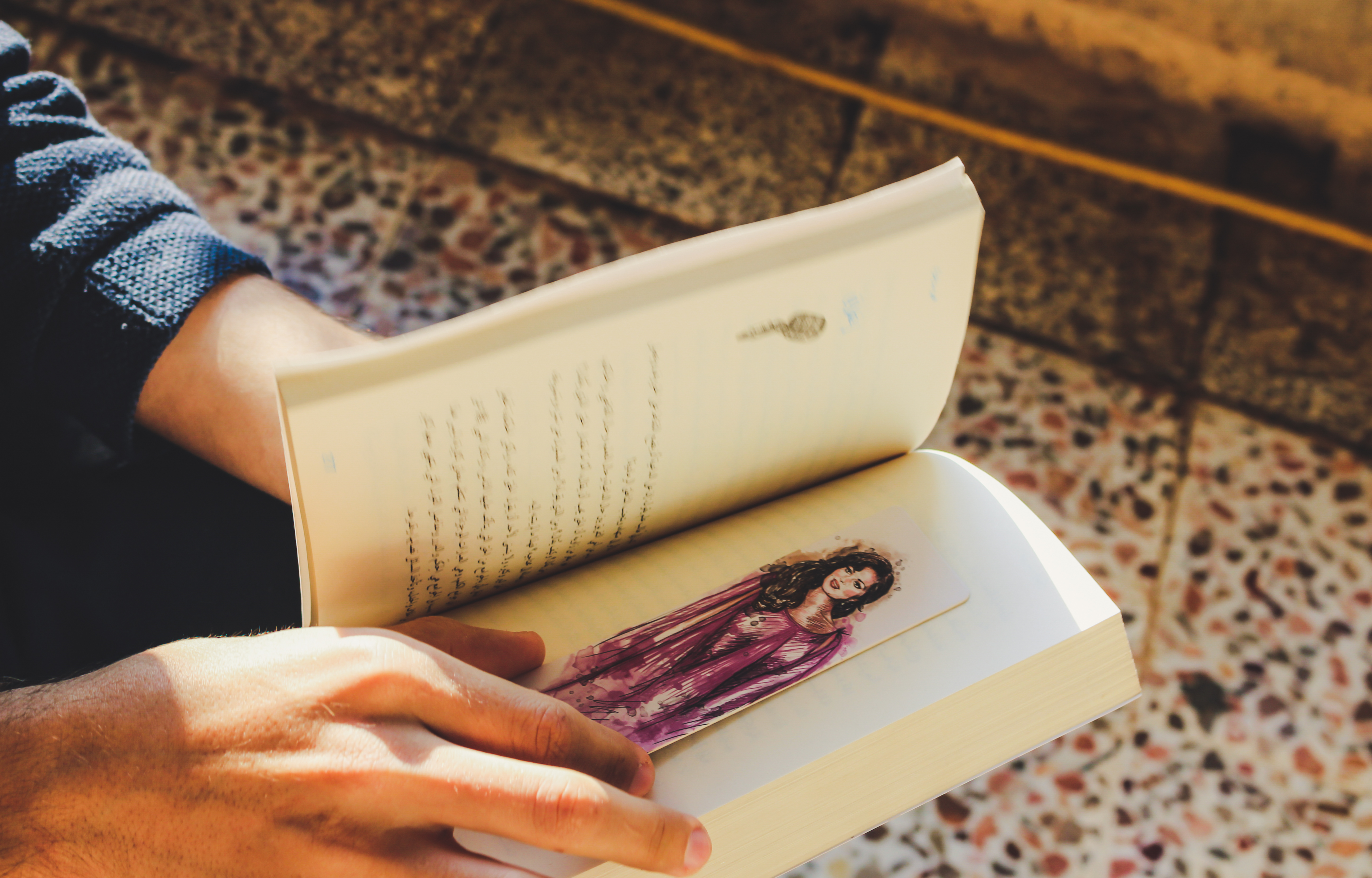 Person Holding Story Book