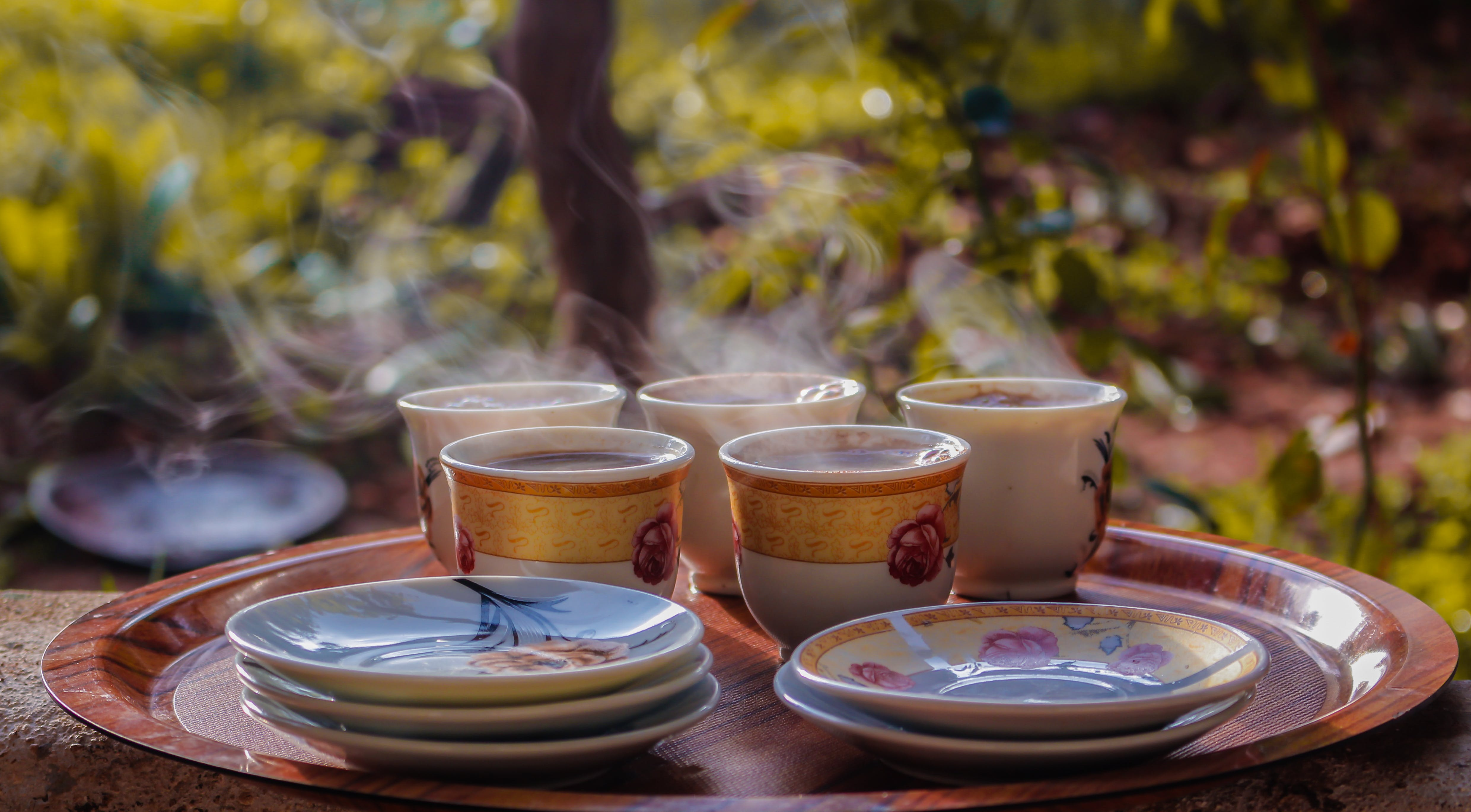 Cups and Saucers on Round Brown Tray