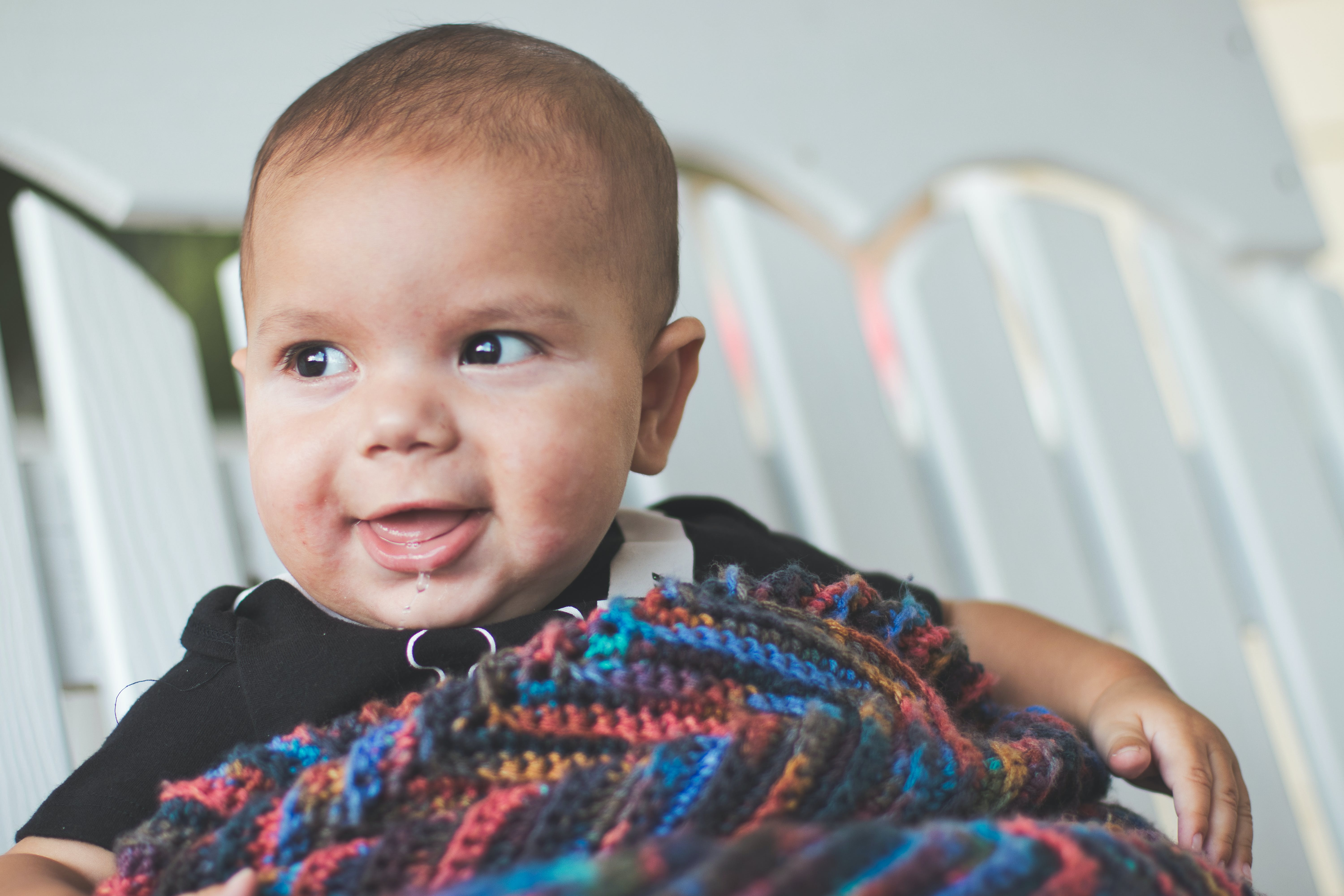Free stock photo of baby, boy, knitted blanket, swing