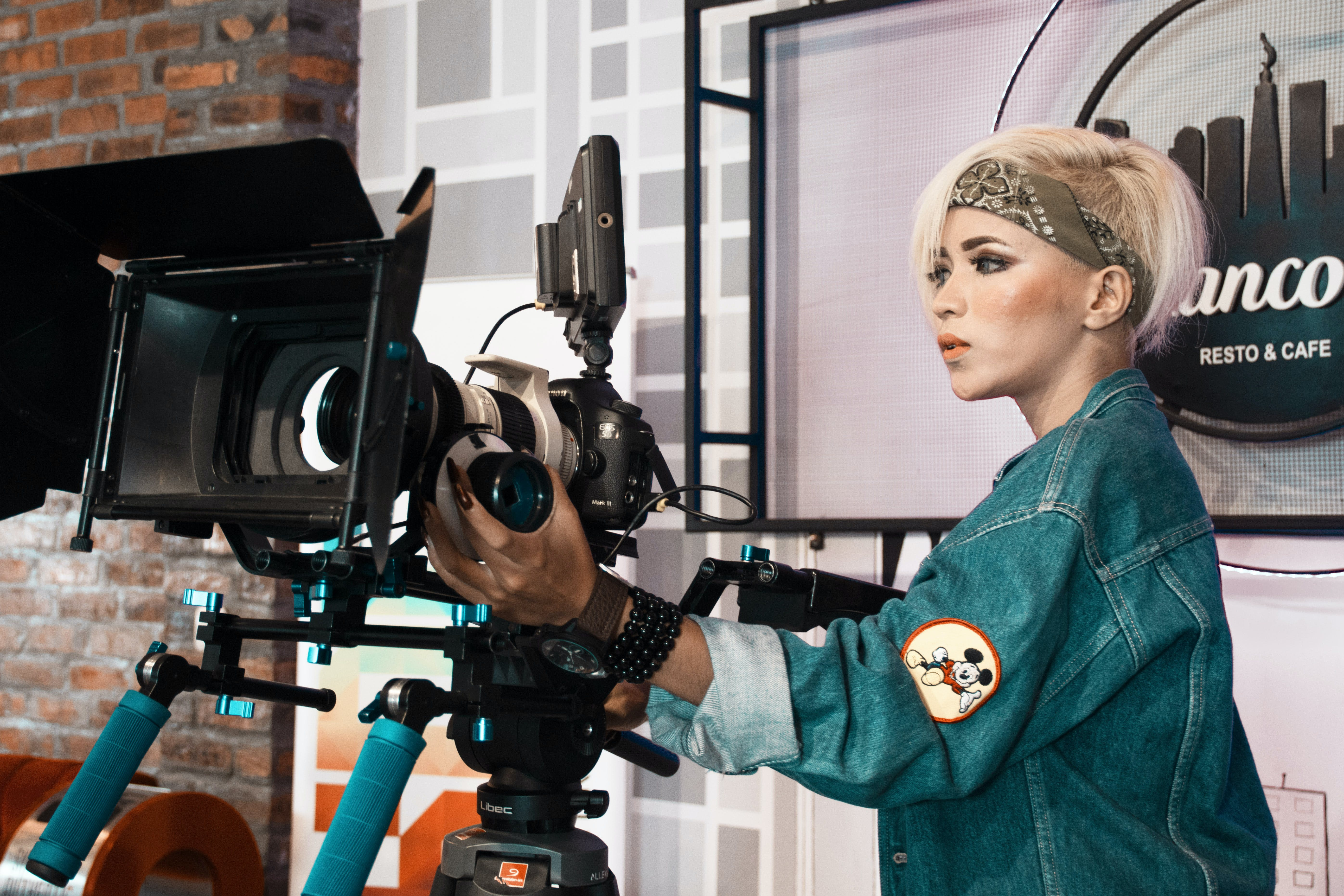 Woman Operating Video Recorder