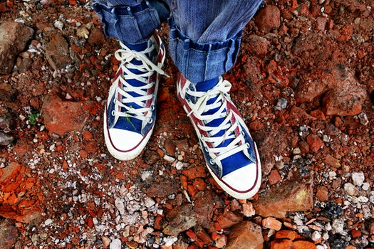 Person in Blue Denim Jeans in Blue and White Sneakers