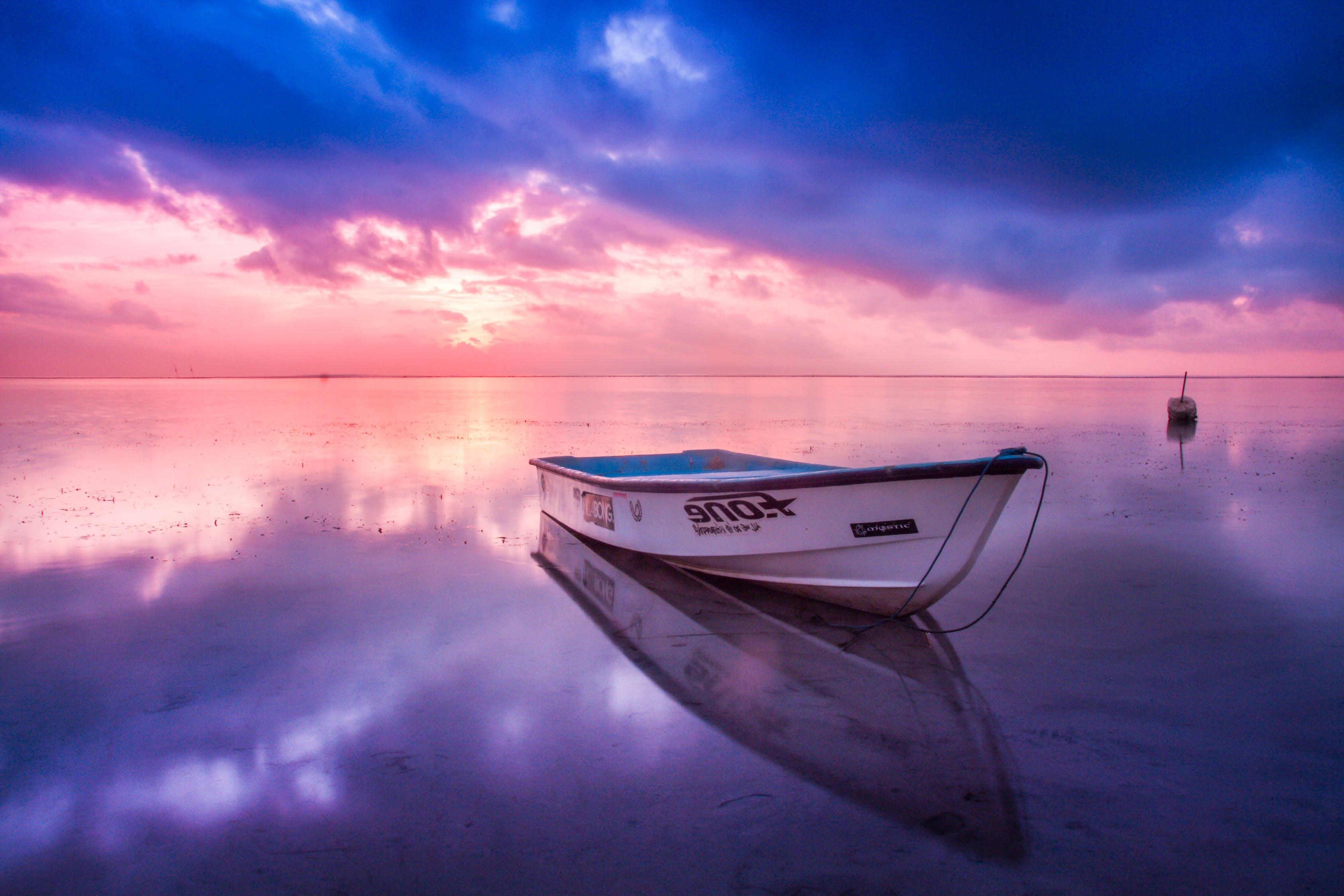 White Boat in Body of Water