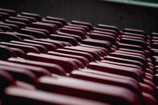 Selective Focus Photograph of Red Oval Shape Equipment