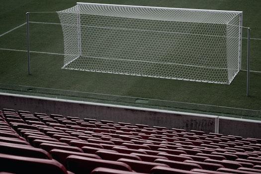 Stadium Seats Near White Soccer Goal
