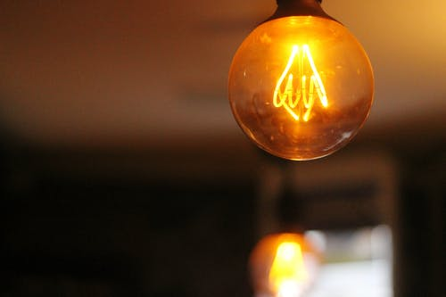 Selective Focus Photography of Turned on Light Bulb