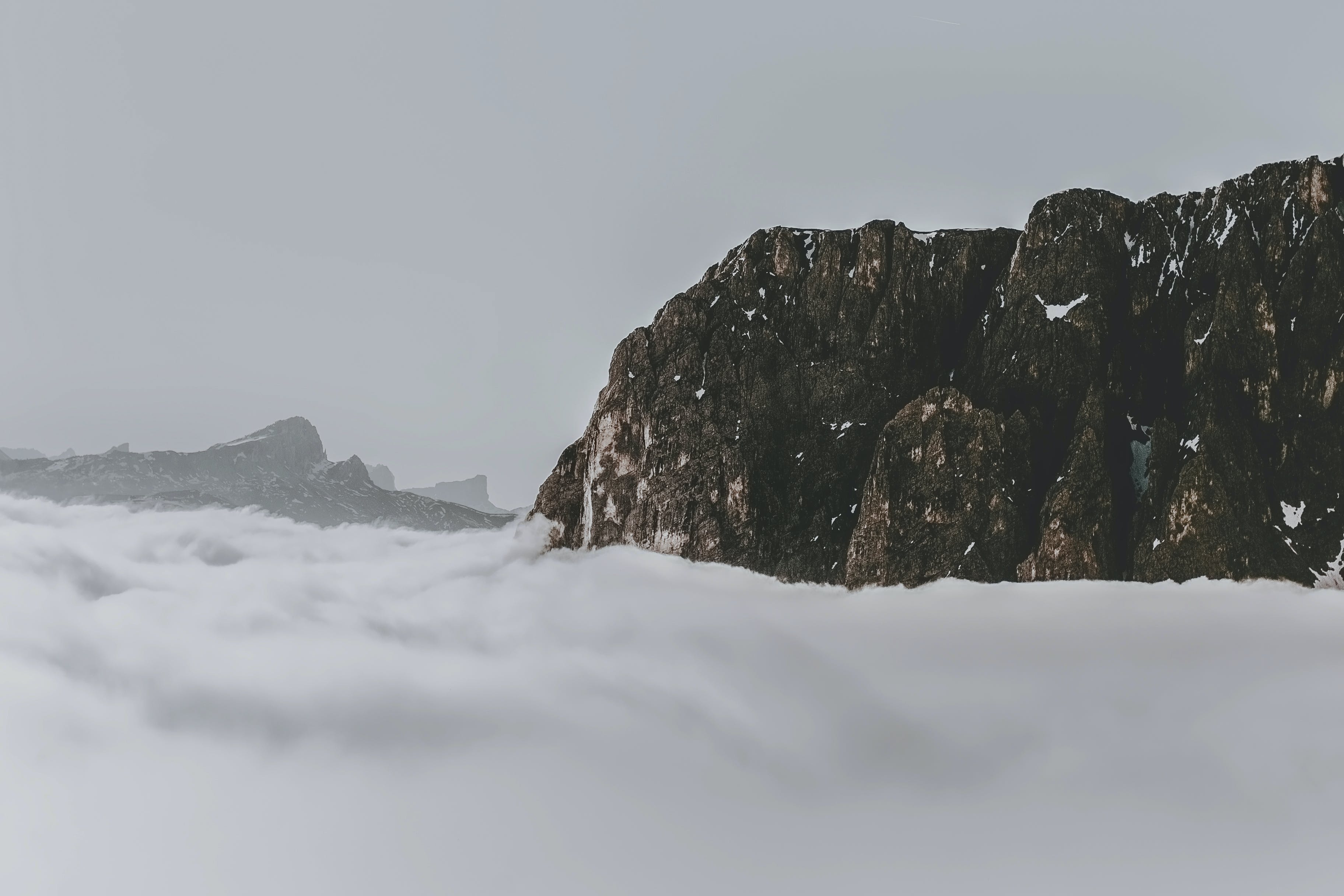 Rock Formation Surrounded by Clouds