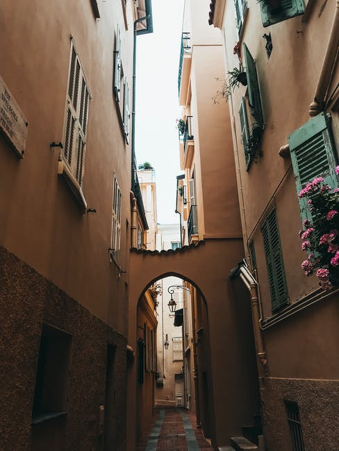 Alley between concrete buildings