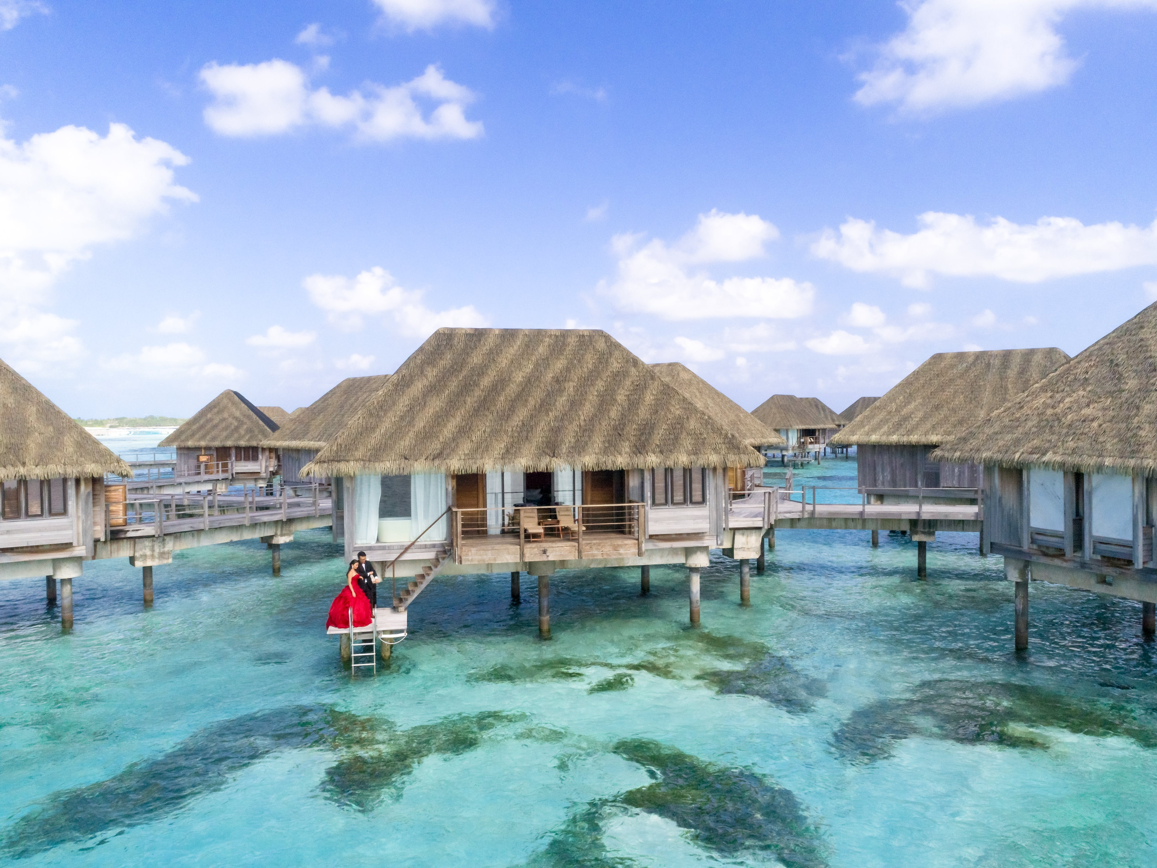 Cluster of Beige Huts Above Water