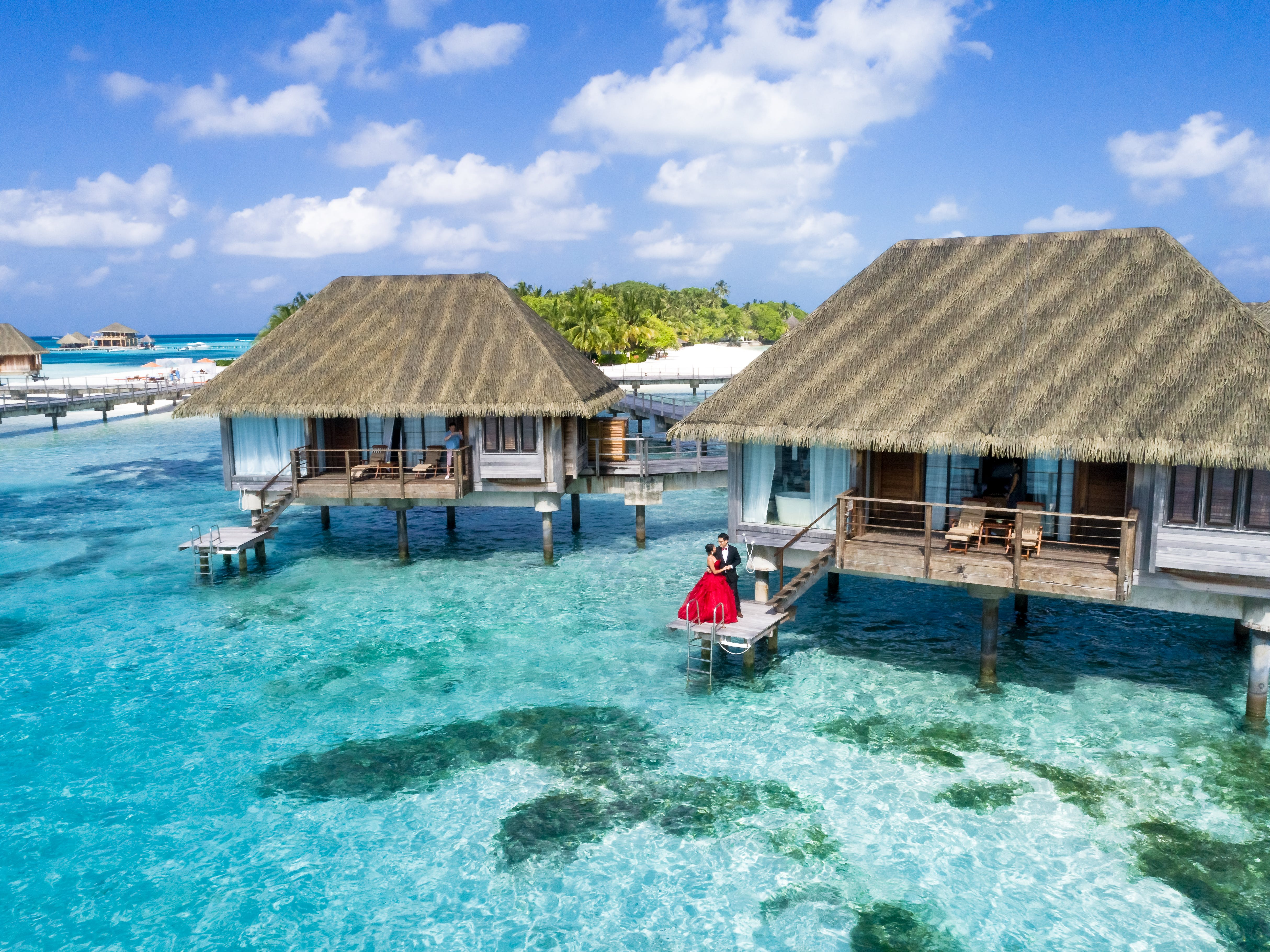 Brown Huts Above Body Of Water