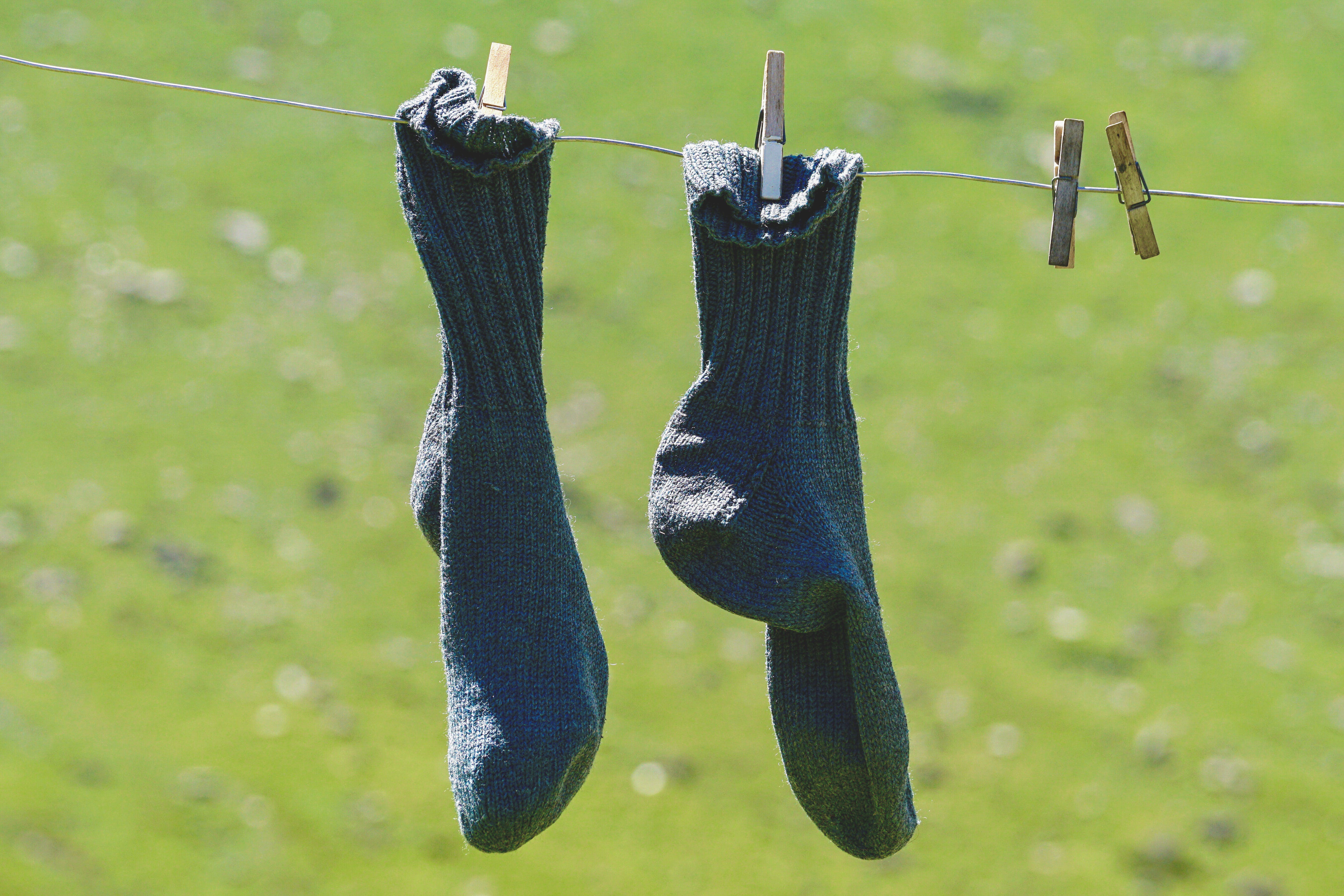 Pair Of Blue Socks Hanging