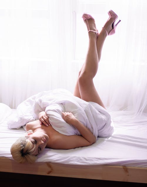 Woman Bending on Bed