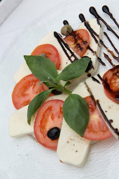 Sliced Tomato on White Ceramic Plate
