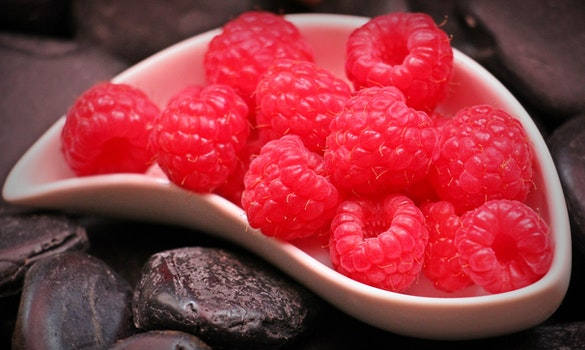 Red Raspberry Fruit on White Ceramic Tray