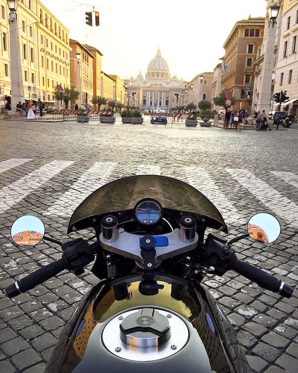 Black Motorcycle in Front of Pedestrian Lane With Orange Traffic Light