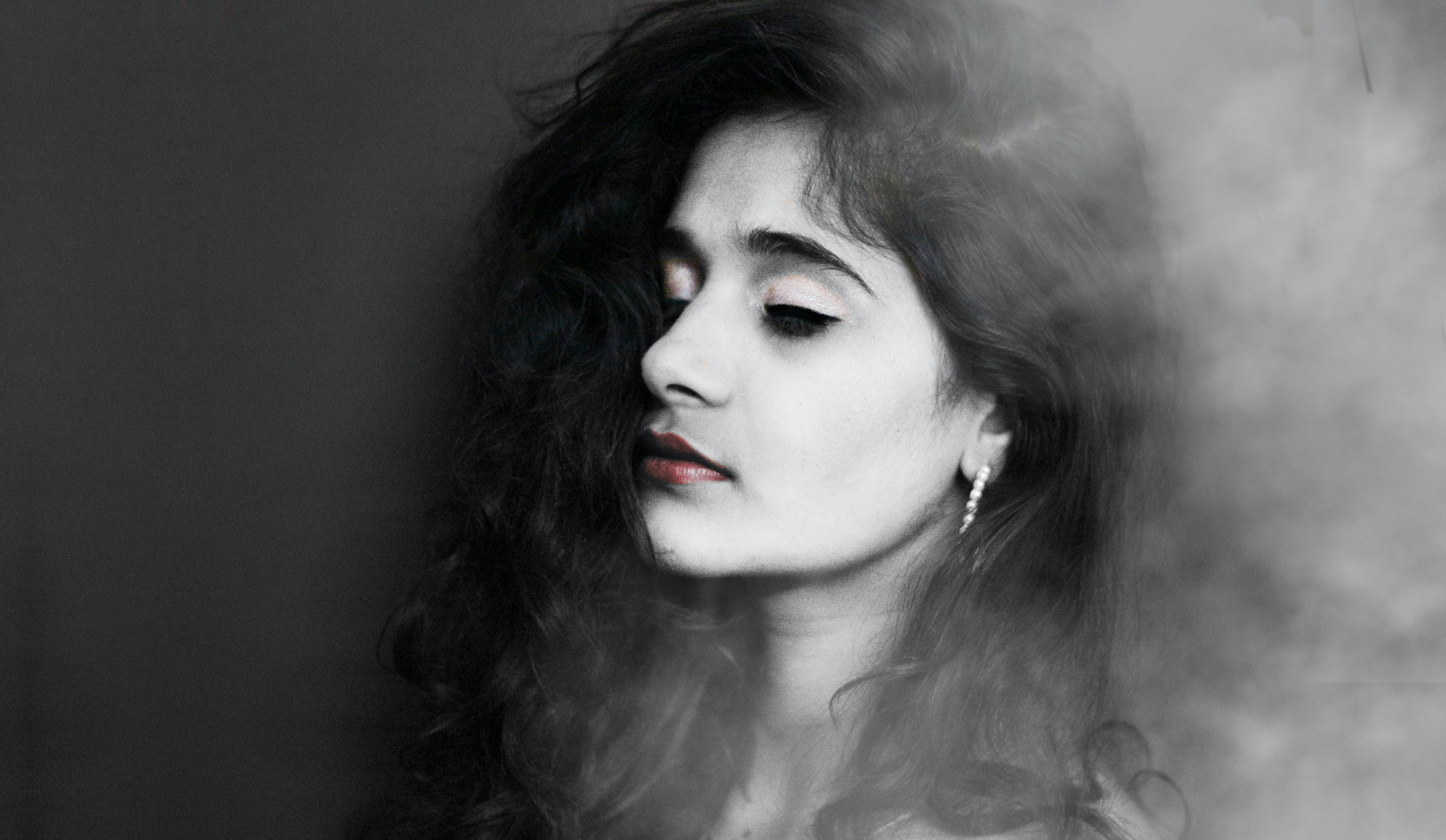Grayscale Photography of Woman With Red Lipstick Wearing Hoop Earrings