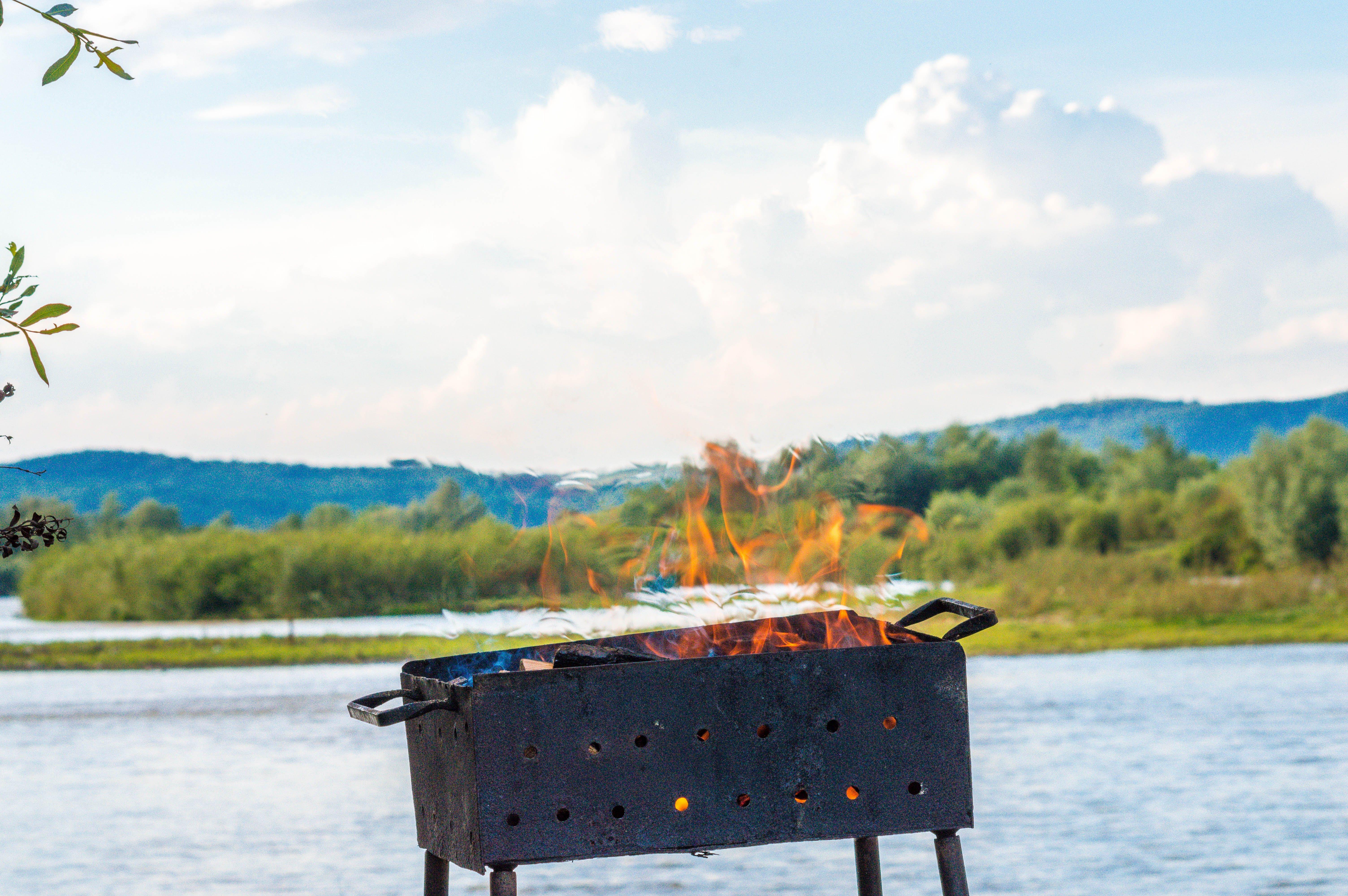 Rectangular Black Metal Lighted Fire Pit Near River