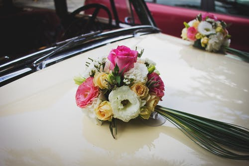 Pink Green and White Flower Bouquet on Beige Car