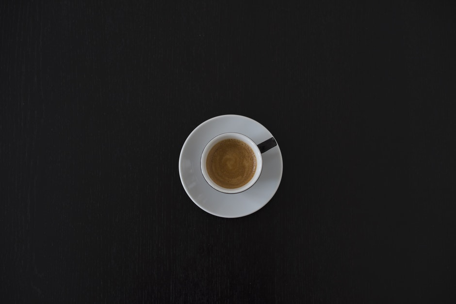 White Ceramic Coffee Cup on White Saucer