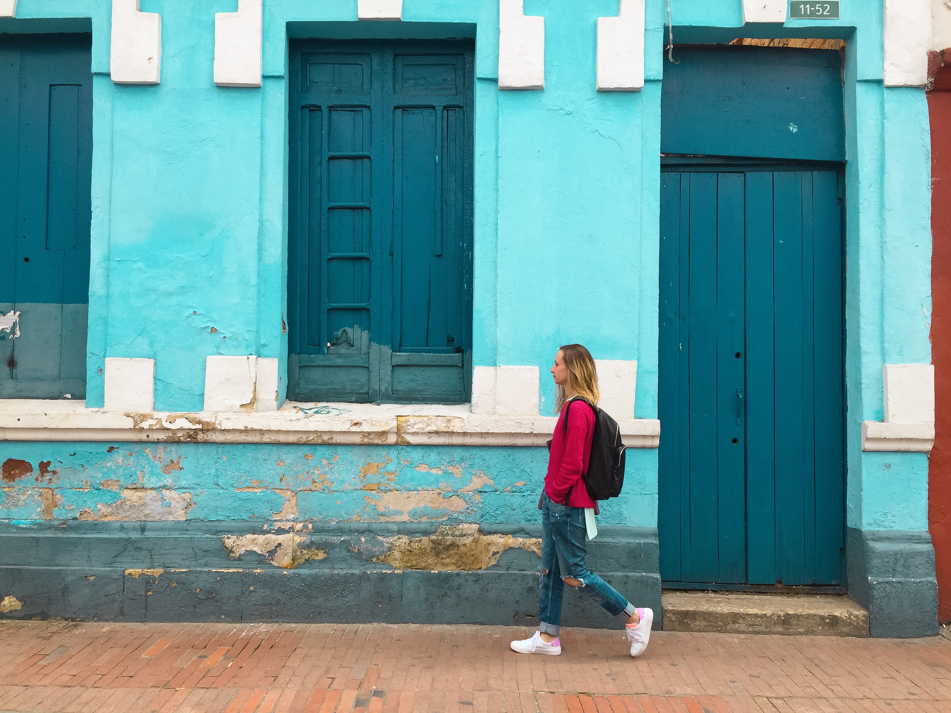 Woman Walking Street With Blue Building