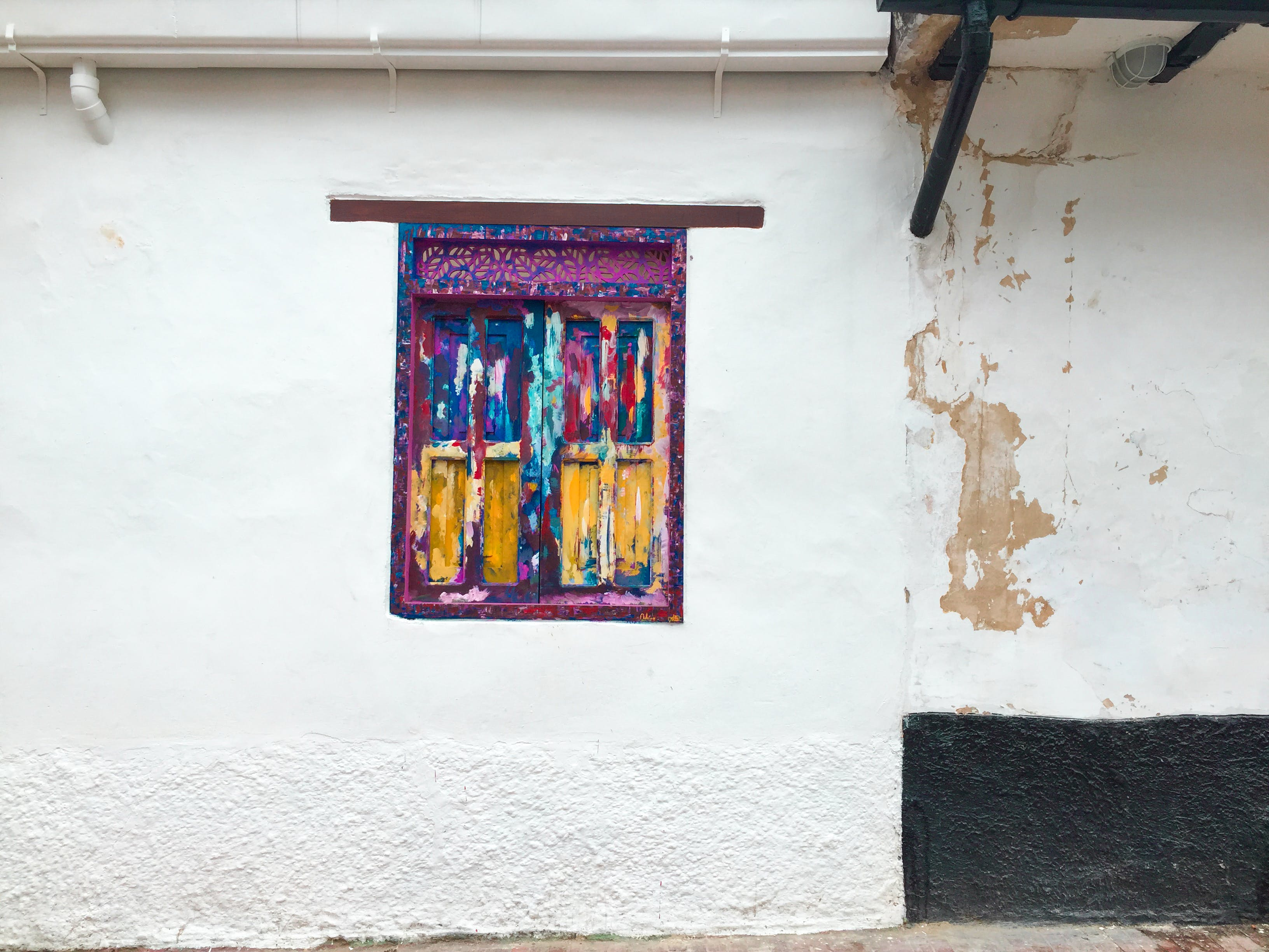 Closed Multicolored Wooden Window