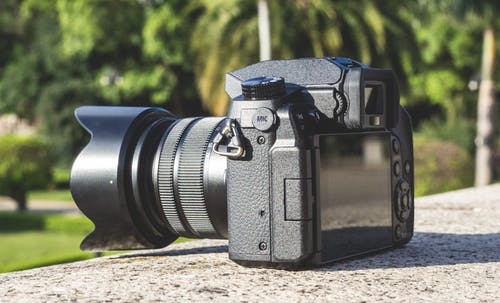 Shallow Focus Photography of Black Dslr Camera