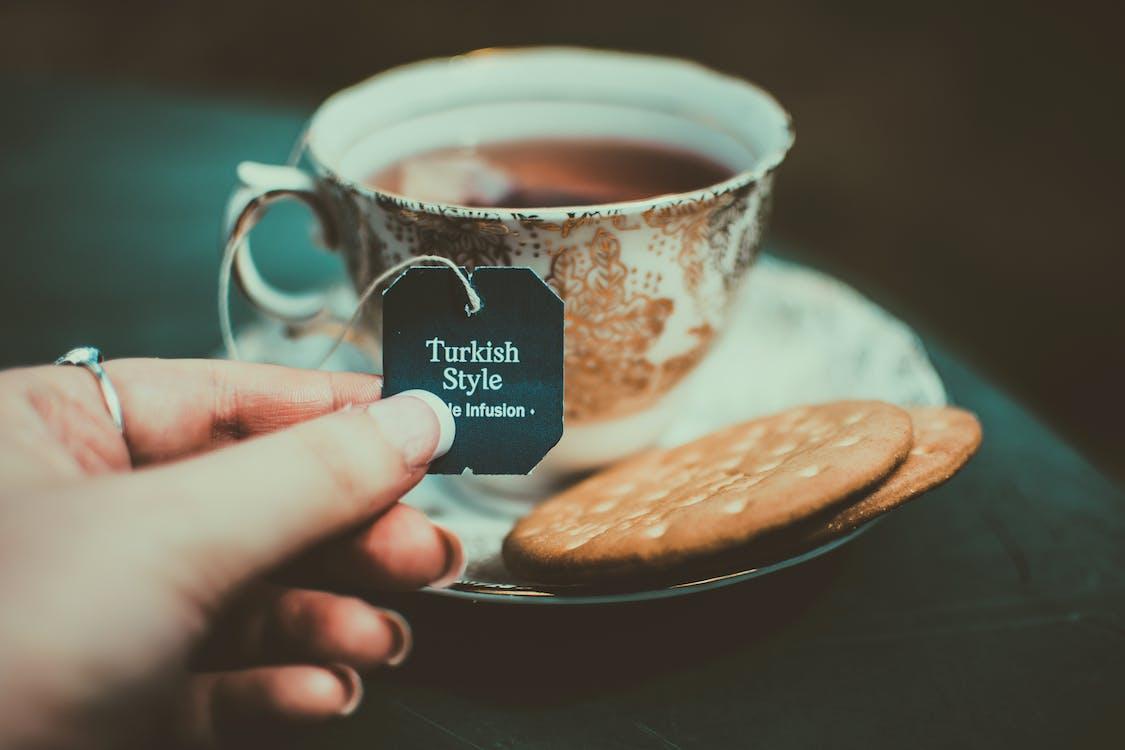 Person Holding Turkish Style Tea Bag Tie