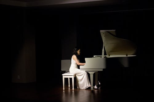 Woman Playing Grand Piano