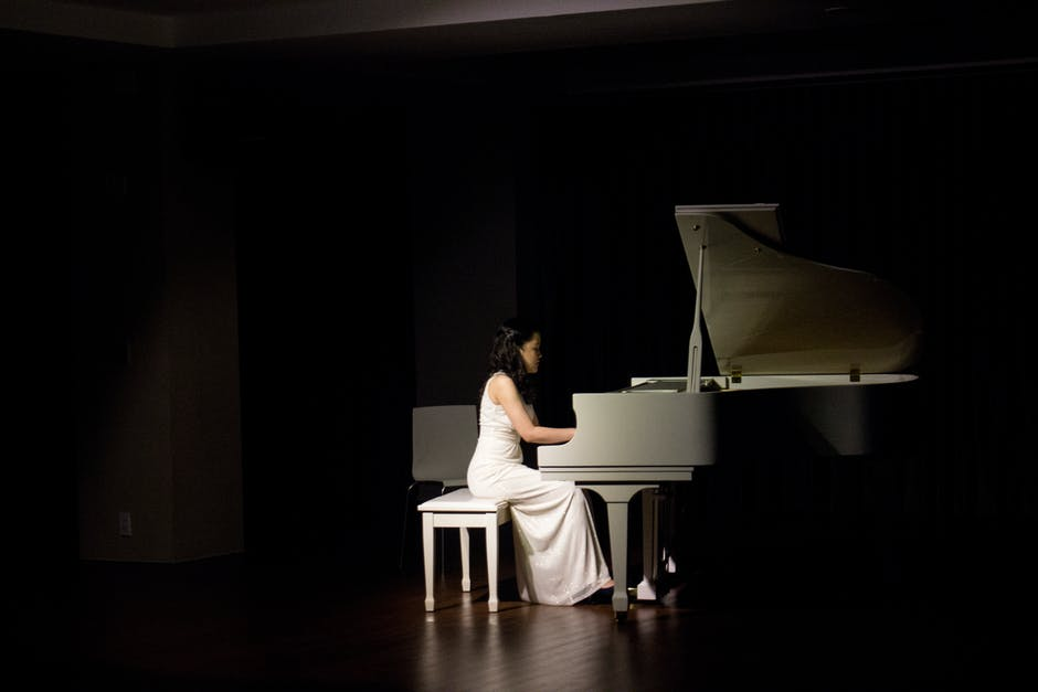 Woman playing grand piano