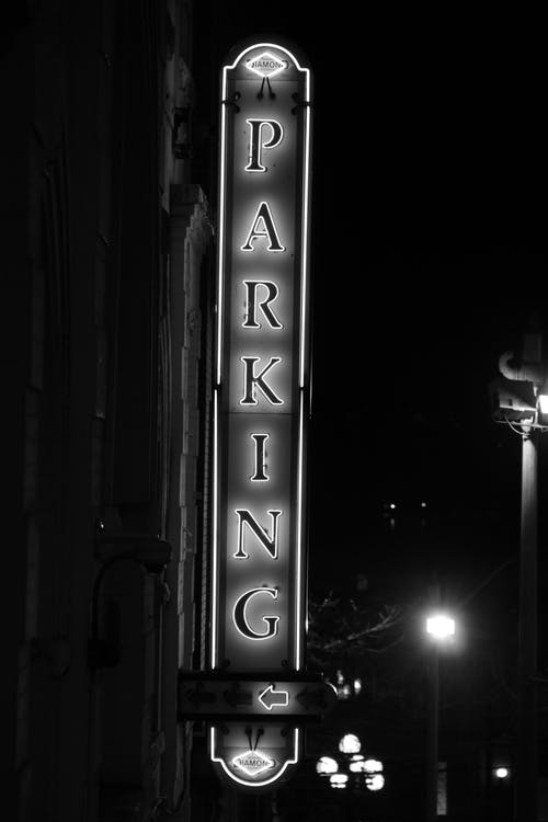 Grayscale Photo of Parking Signage