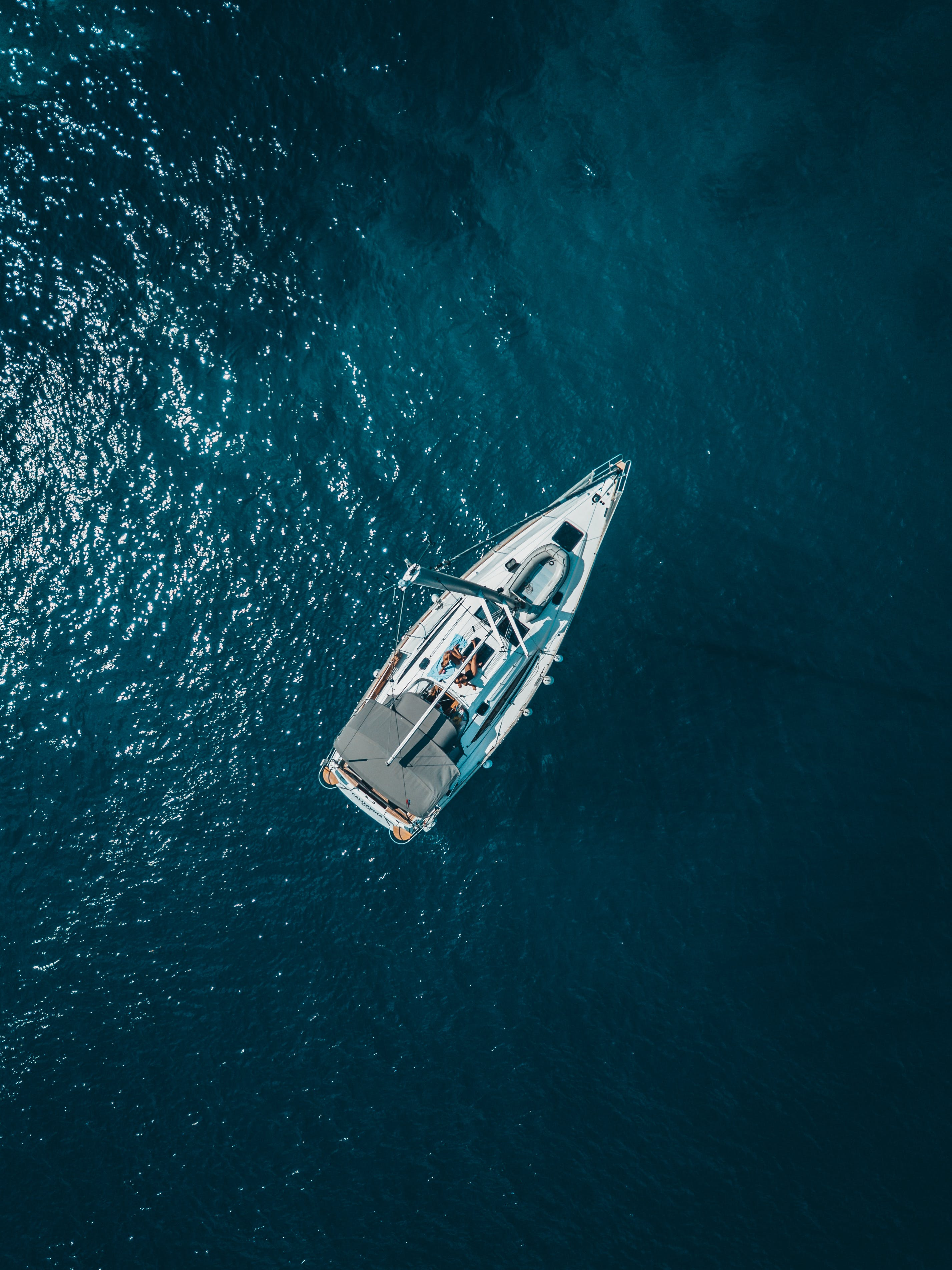High Angle Photo of White Boat on Body of Water