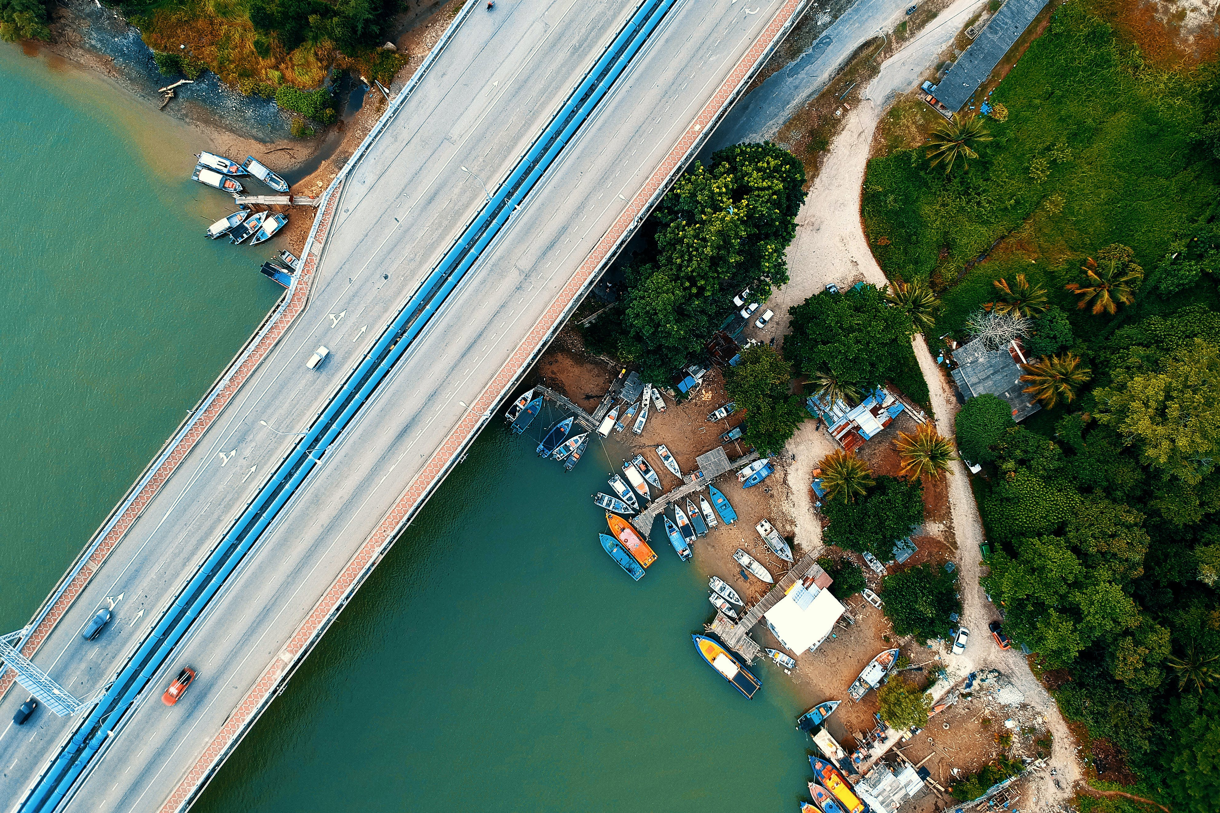 Aerial Photo Photography of Vehicle Passing Through the Bridge