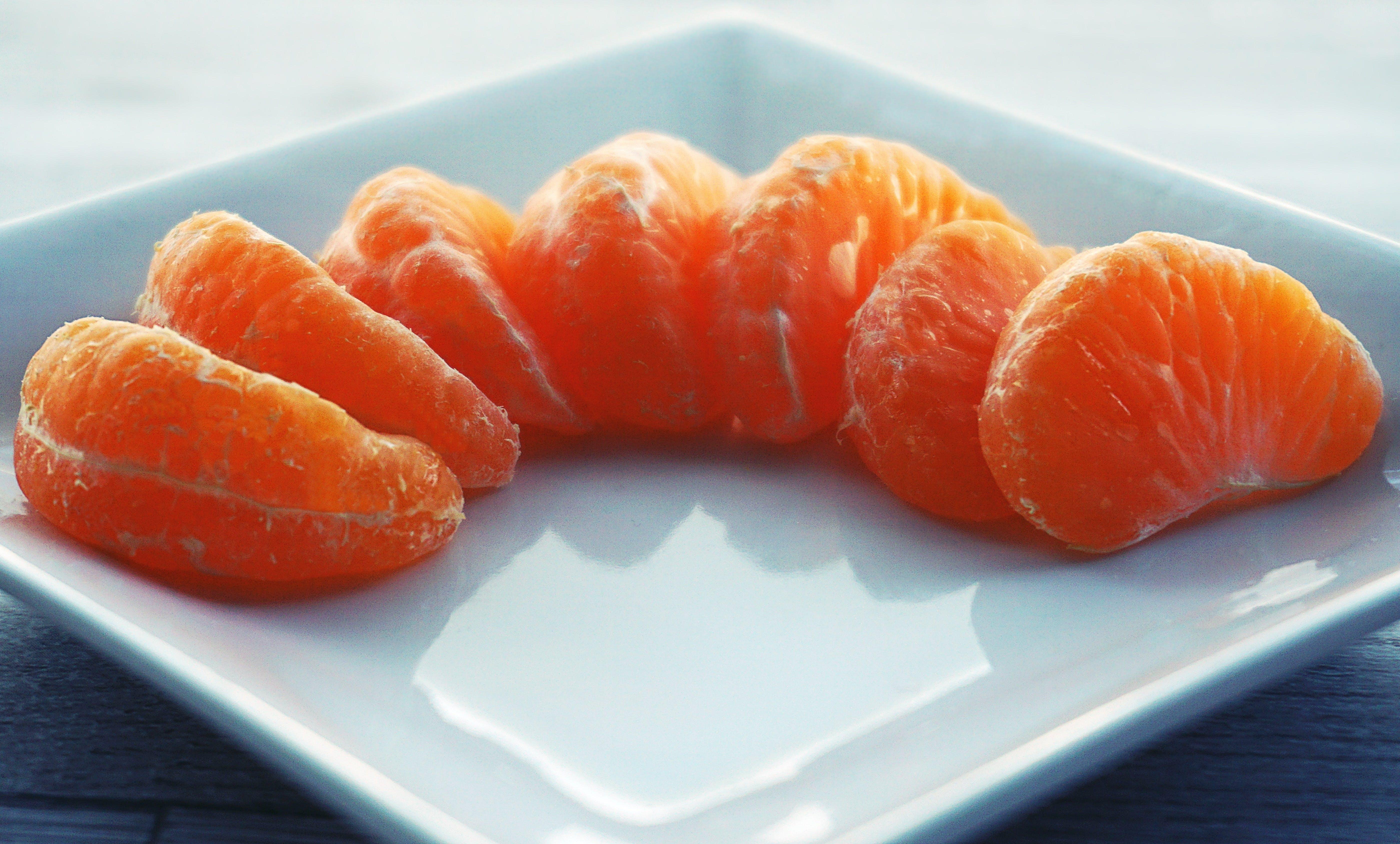 Orange Fruit on White Ceramic Saucer