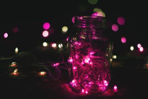 Pink String Lights on Clear Glass Mason Jar