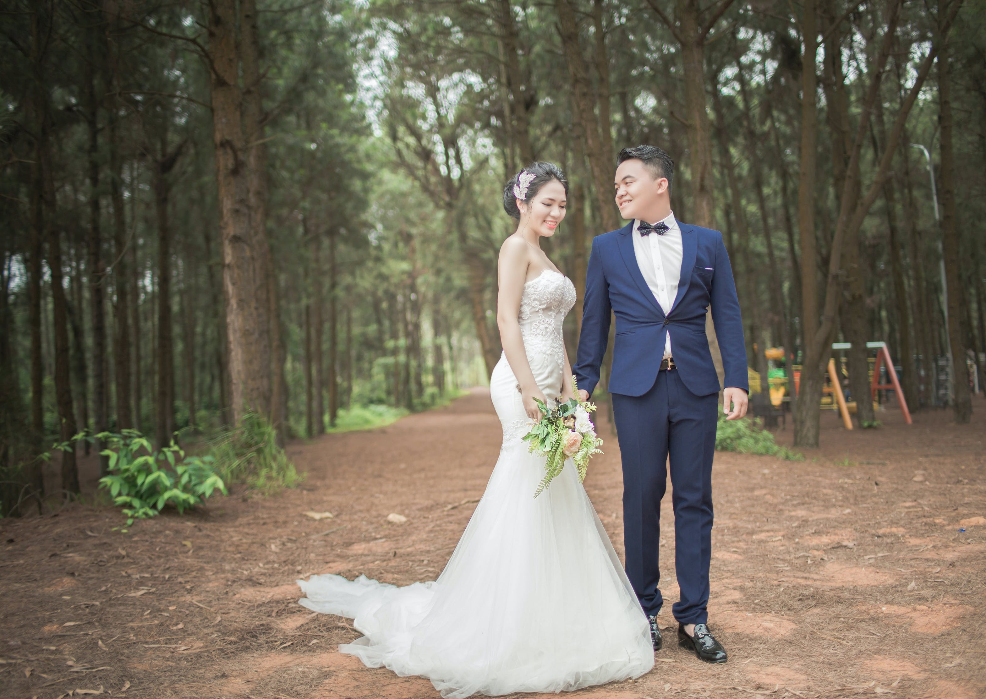Wedding Couples Between Tall Trees