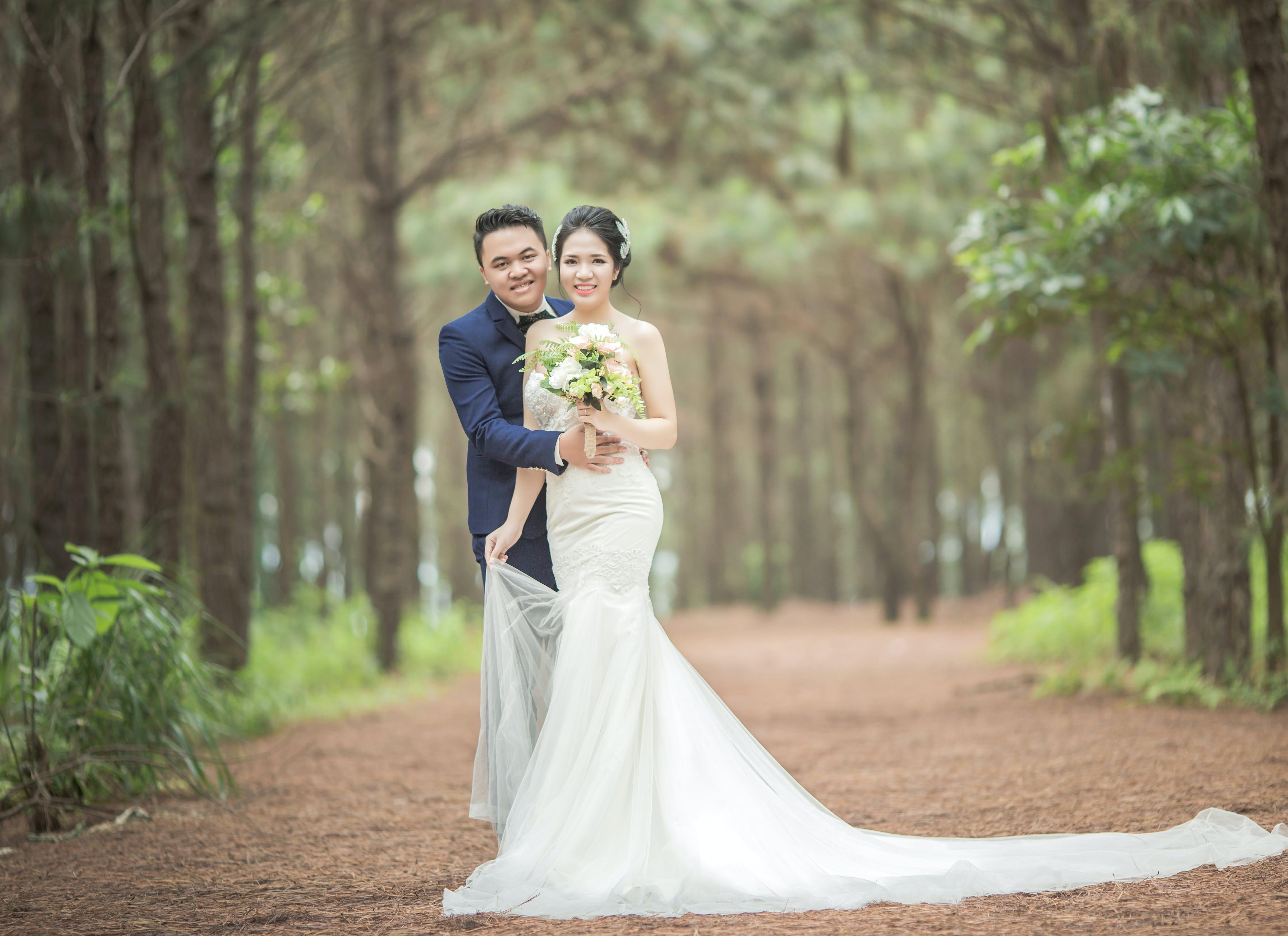 Man Wearing Black Suit Jacket and Women Wearing White Wedding Dress